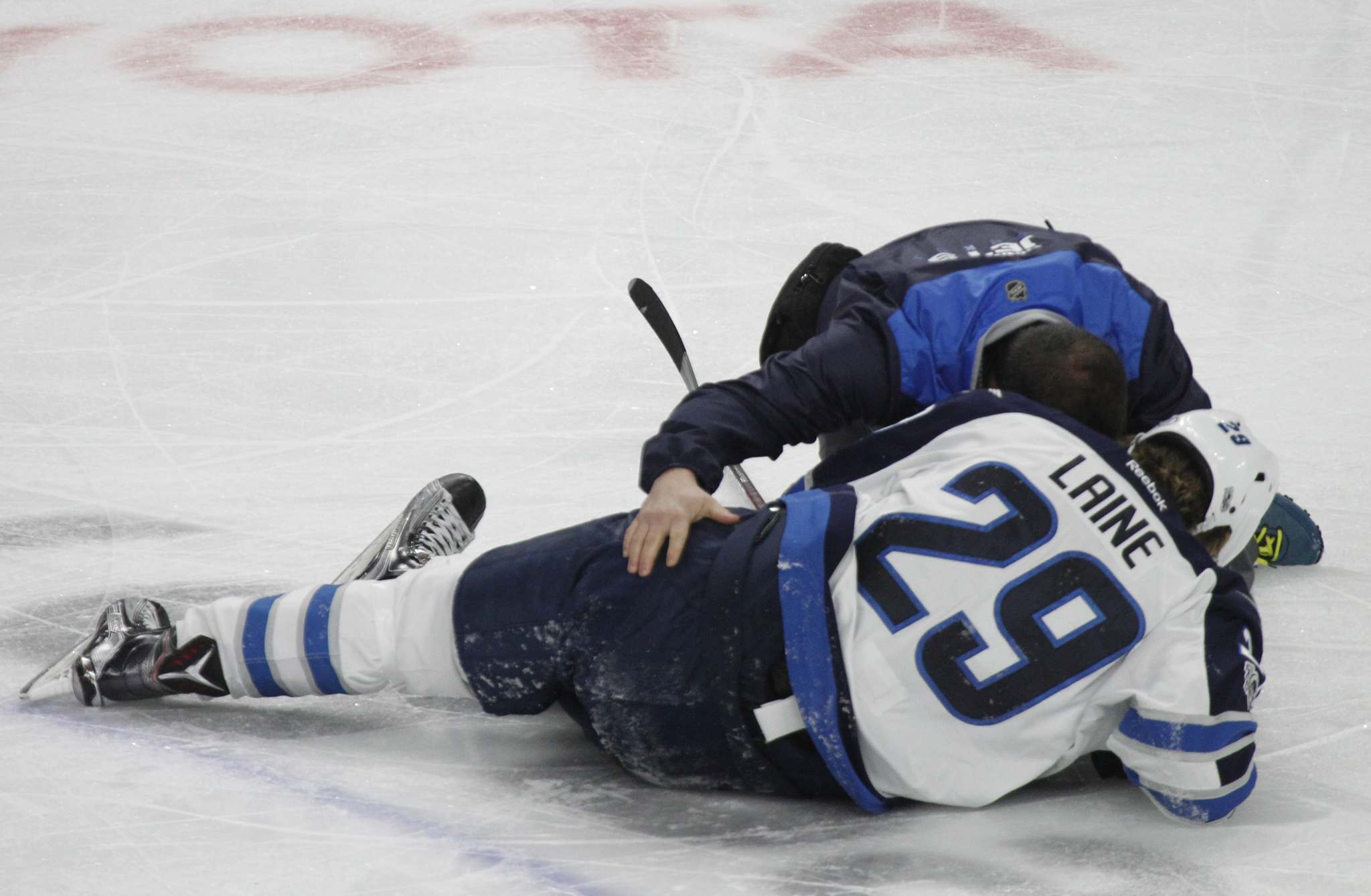 JEFFREY T. BARNES / THE ASSOCIATED PRESS FILES</p><p>Winnipeg forward Patrik Laine is helped by a trainer after getting hit by Buffalo's Jake McCabe during a game on Saturday in Buffalo.</p>