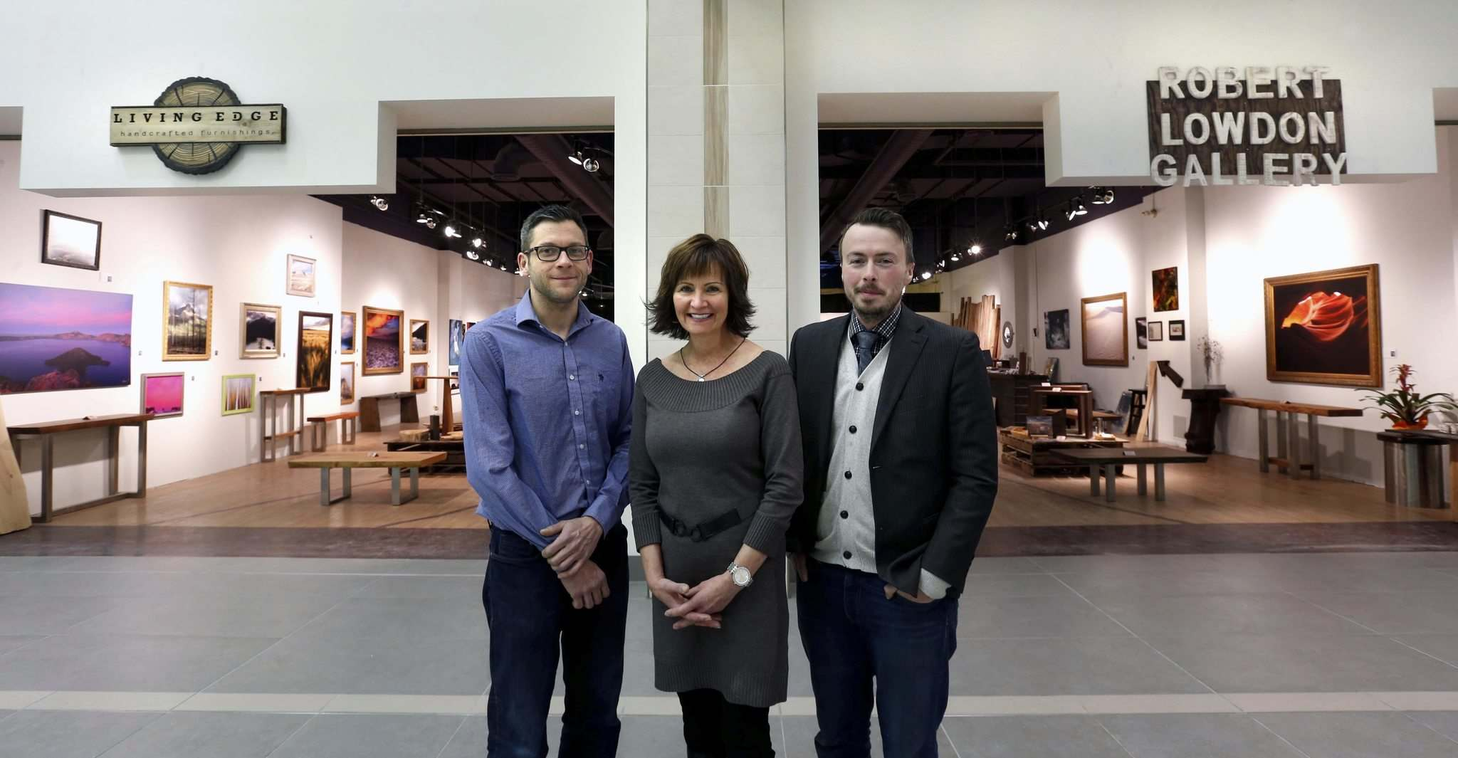 WAYNE GLOWACKI / WINNIPEG FREE PRESS</p><p>Cheryl Roney, director of leasing for Triovest, with Robert Lowdon (right), owner of Robert Lowdon Gallery and Ryan Henderson, owner of Living Edge Furnishings, in front of their shared space on the main floor at Cityplace 333 St. Mary Ave. at Hargrave. </p>