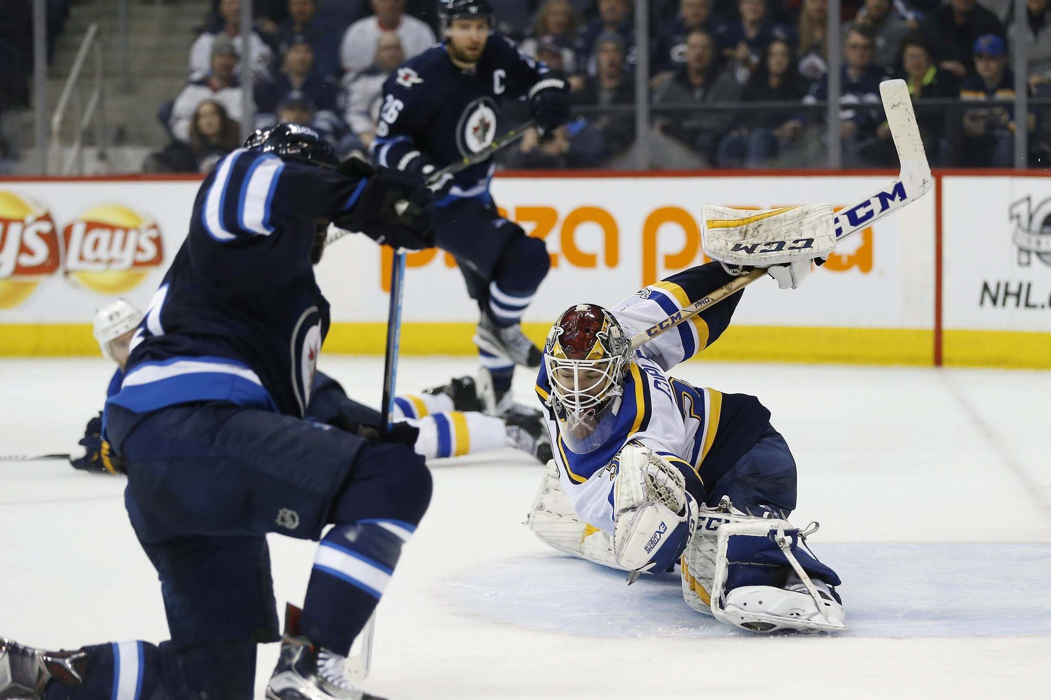 JOHN WOODS / THE CANADIAN PRESS</p><p>St. Louis Blues goaltender Pheonix Copley makes an heroic save on Winnipeg Jets' Mathieu Perreault during the second period, Saturday. </p>