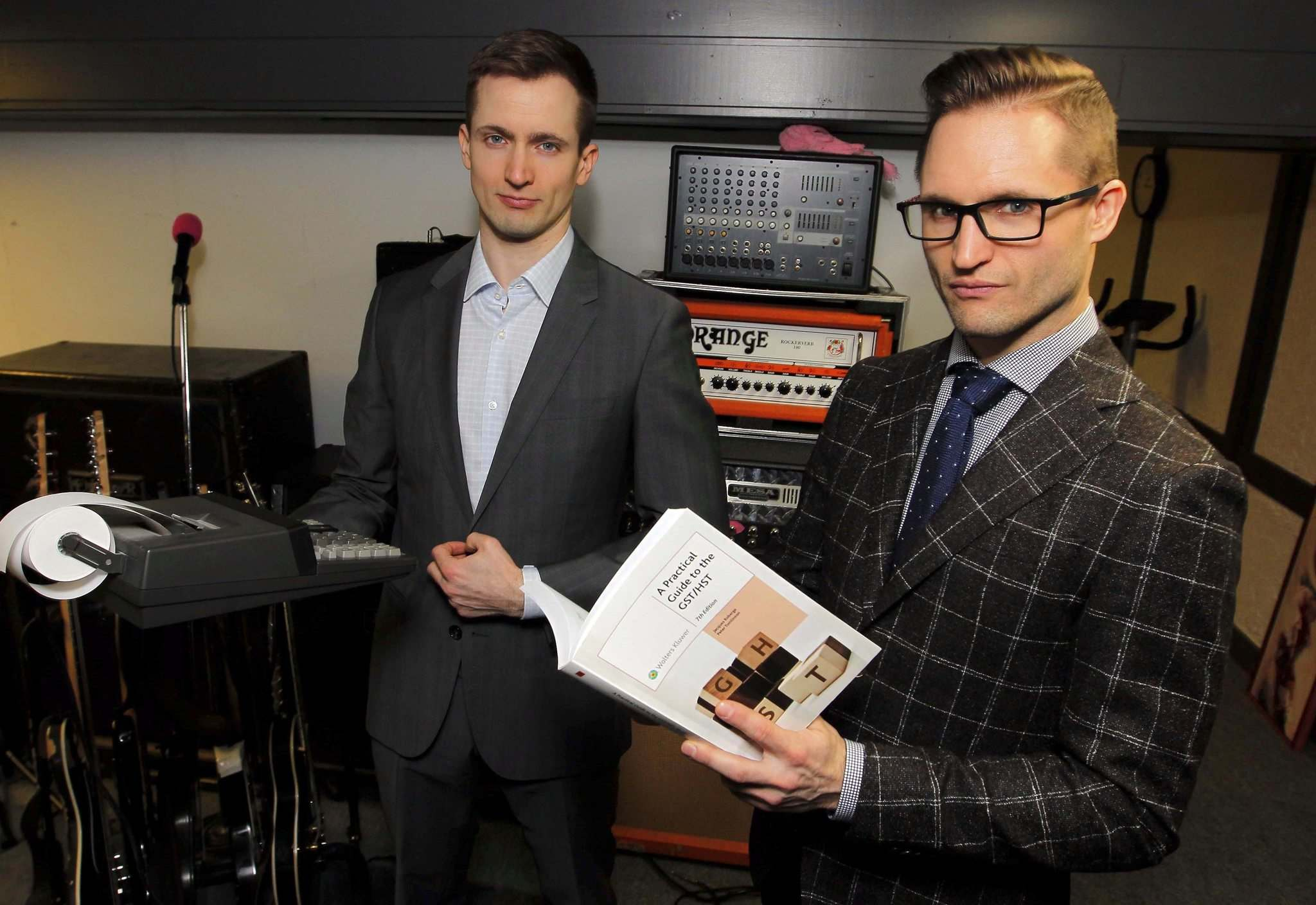 BORIS MINKEVICH / WINNIPEG FREE PRESS</p><p>MKM Management Services, Shane Matthewson (left) and Jesse Matthewson (right), a.k.a. noise-rockers KEN mode, with the tools of their trades: amps, guitars, microphones, business suits, calculators and tax guides.</p></p>