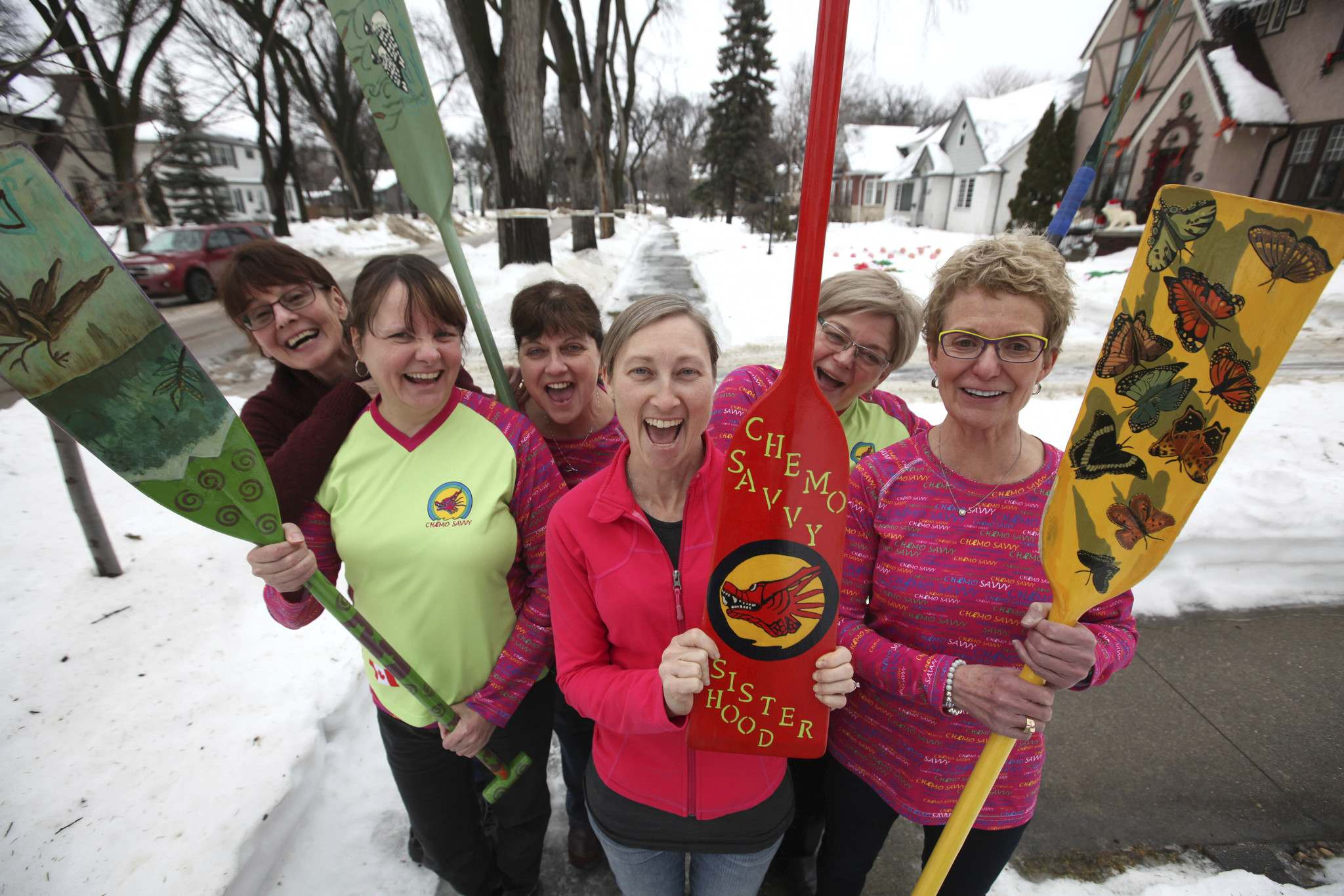 RUTH BONNEVILLE / WINNIPEG FREE PRESS</p><p>From left: Debbie Burns, Cathy Prusak, Mary McCormick, Tammy MacDonald, Marleen Roy and Louise Welsh, some of the members of Chemo Savvy&#39;s dragon boat team, show off the paddles they designed.</p>