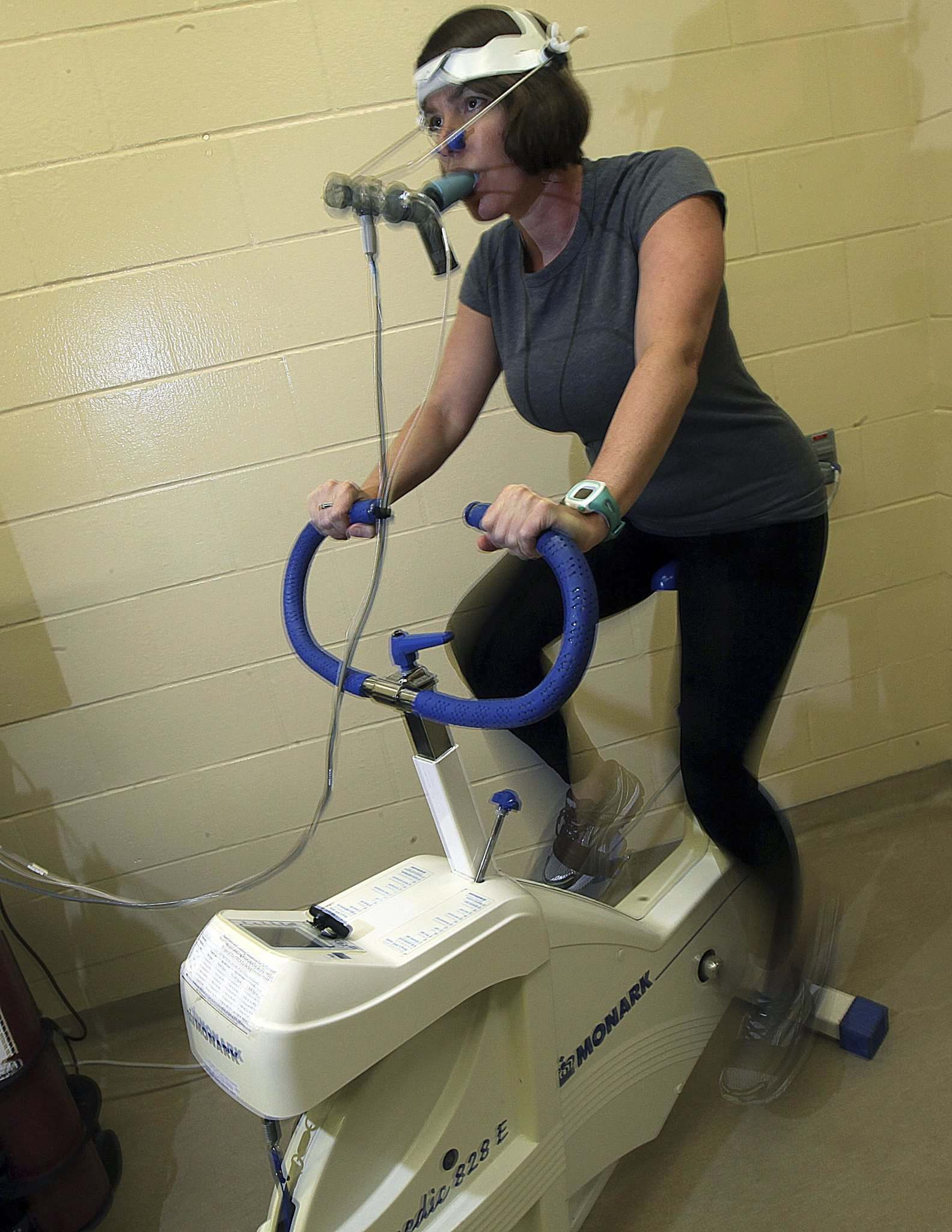 The physical activity test involves riding a stationary bicycle while wearing a spirometry mask.</p></p>