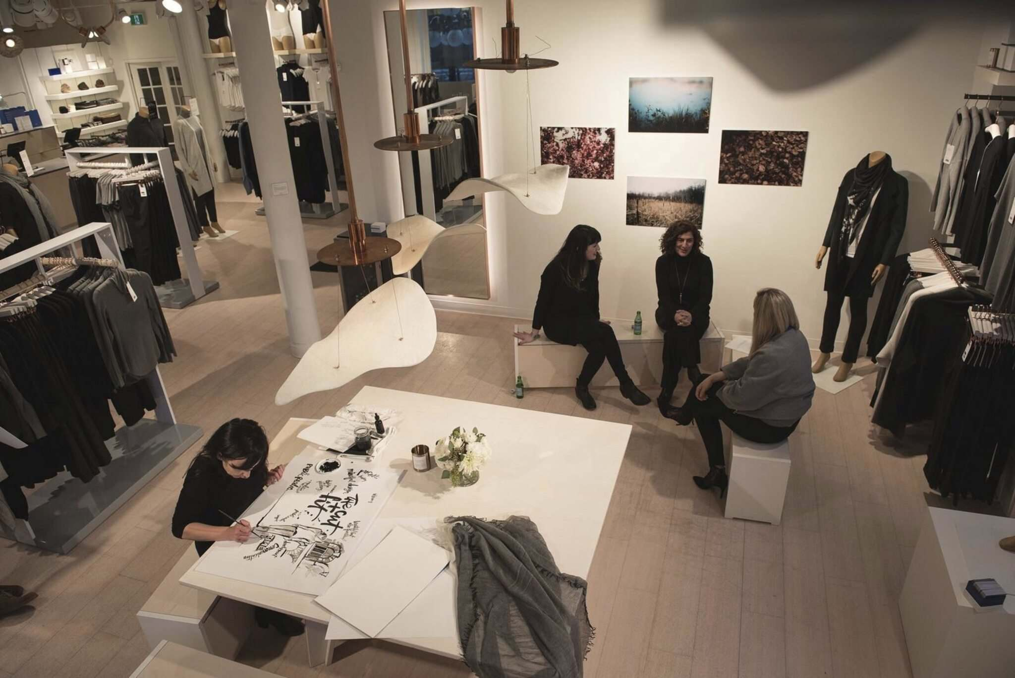 David Moder Photography</p><p>Landscape architects Kaili Brown, left, and Constantine Douvris discuss design ideas with Kit and Ace manager Jane Puchniak while artist Kal Barteski takes notes.</p></p>
