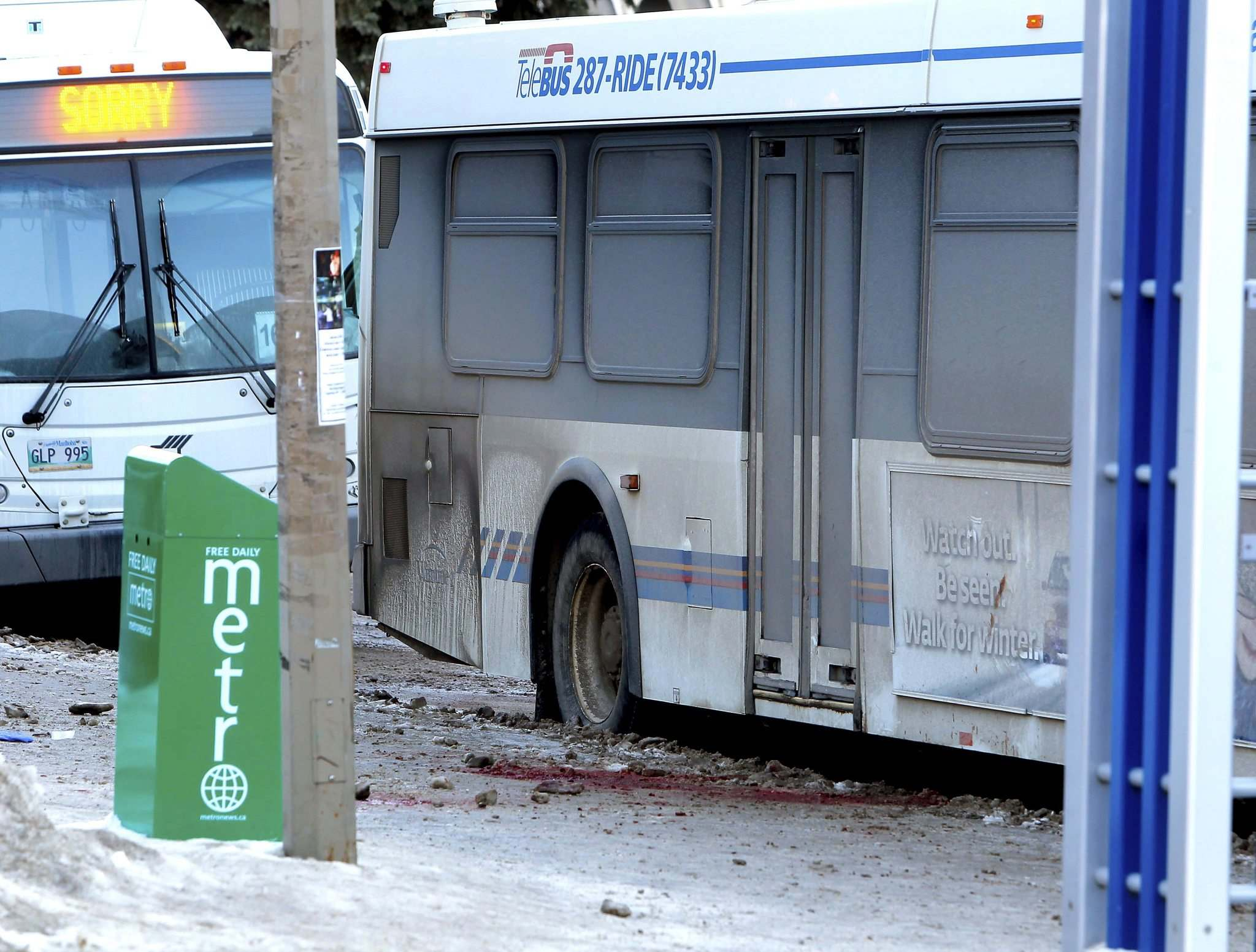 A blood-soaked sidewalk remains as police investigate at the scene of a fatal stabbing of a bus driver at the University of Manitoba.