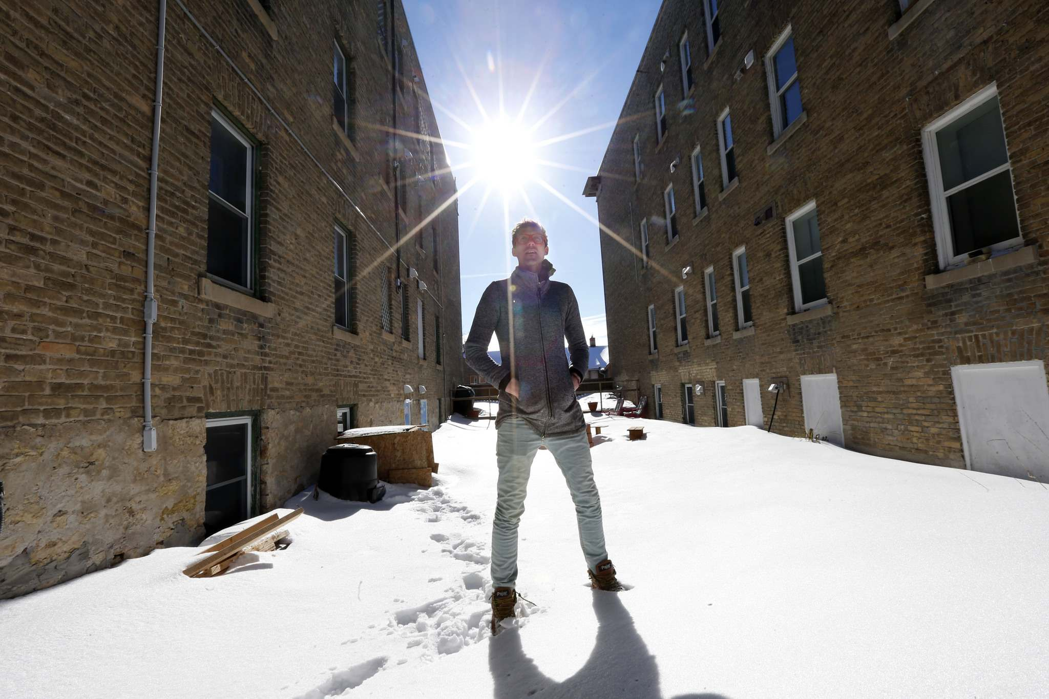 Nicolas Geddert in the courtyard of his building at 821 St. Paul Avenue where some residents are hoping to get a composting project up and running.</p>