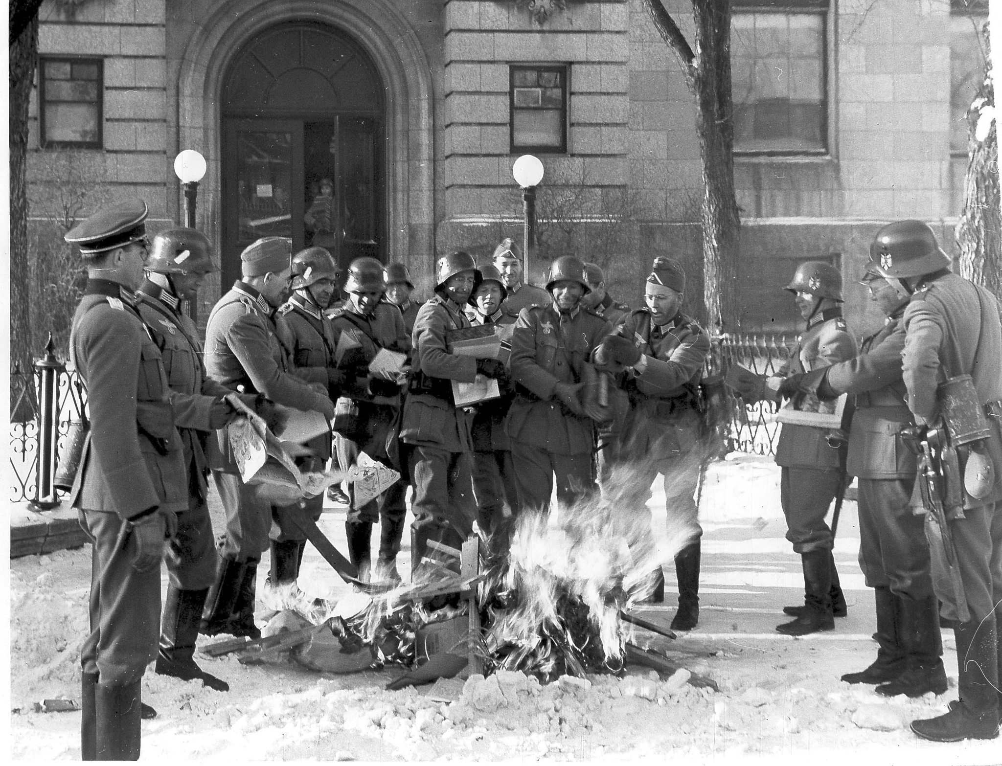 WINNIPEG FREE PRESS FILES</p><p>Men portraying German soldiers burn books outside the Carnegie Library.