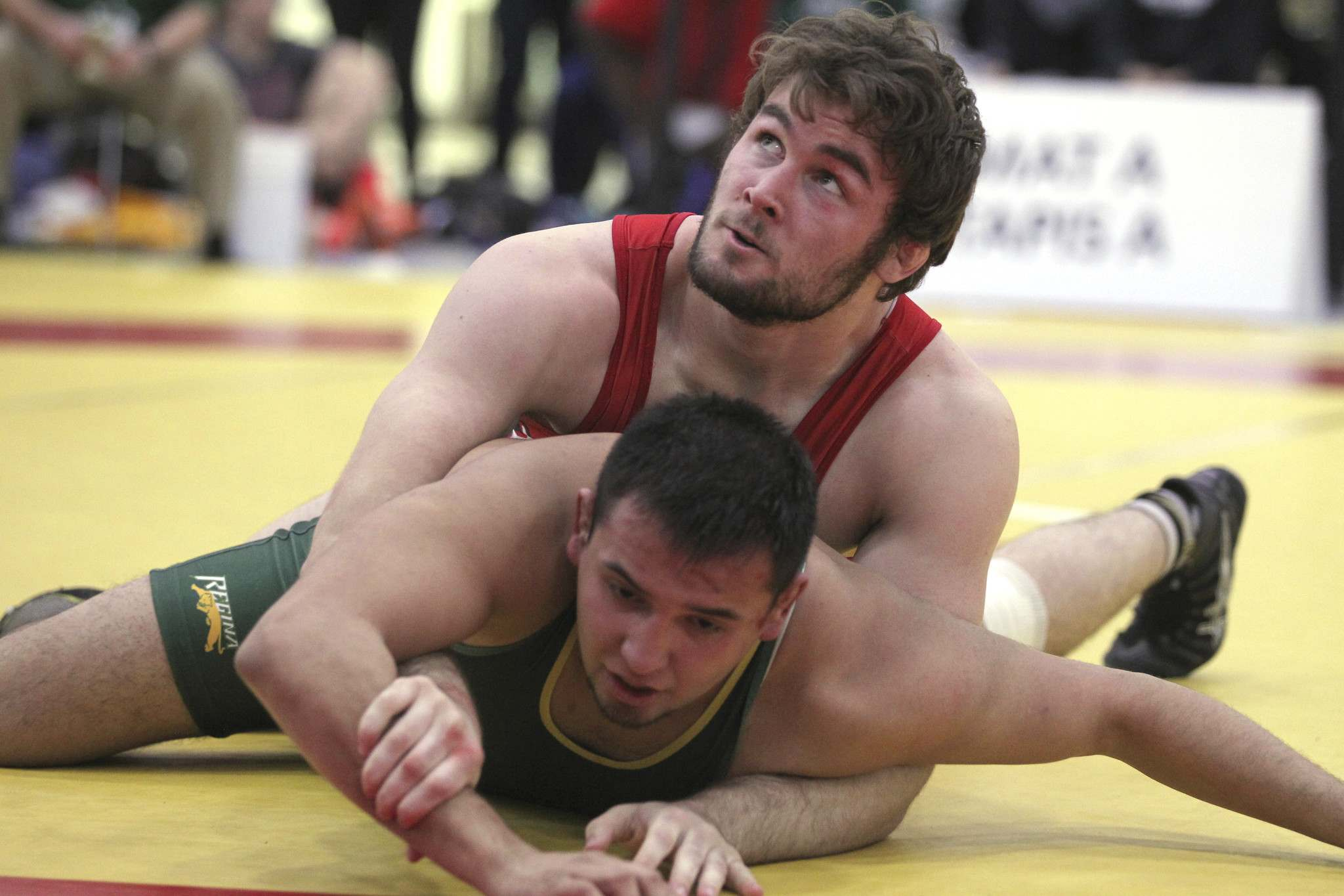 <p>Finn Higgins with University of Winnipeg Wesmen (in red) competes against Waylon Decoteau of the Regina Cougars in the men&#39;s 100-kilogram weight class at the U Sports national wrestling championships at Axworthy RecPlex Saturday. Higgins won the match to capture a gold medal at the event.</p>