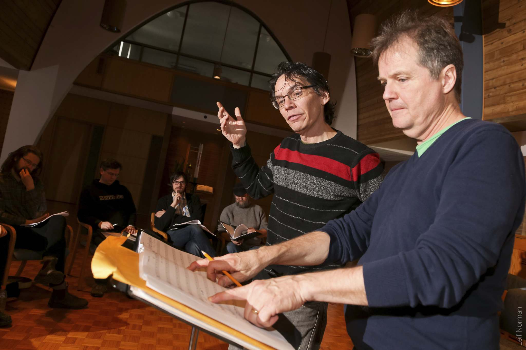Leif Norman photo</p><p>Camerata Nova artistic director Andrew Balfour goes over a score with conductor Mel Braun.</p></p>