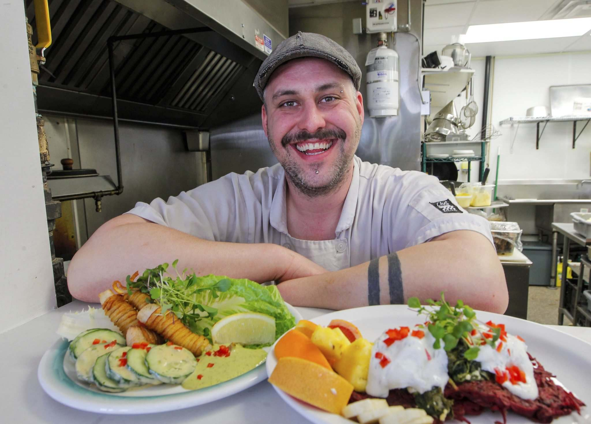 </p><p>Chef Leighton Fontaine of the Village Diner presents some of his most popular dishes: pickerel fingers (left) and potato and beet latkes.</p>