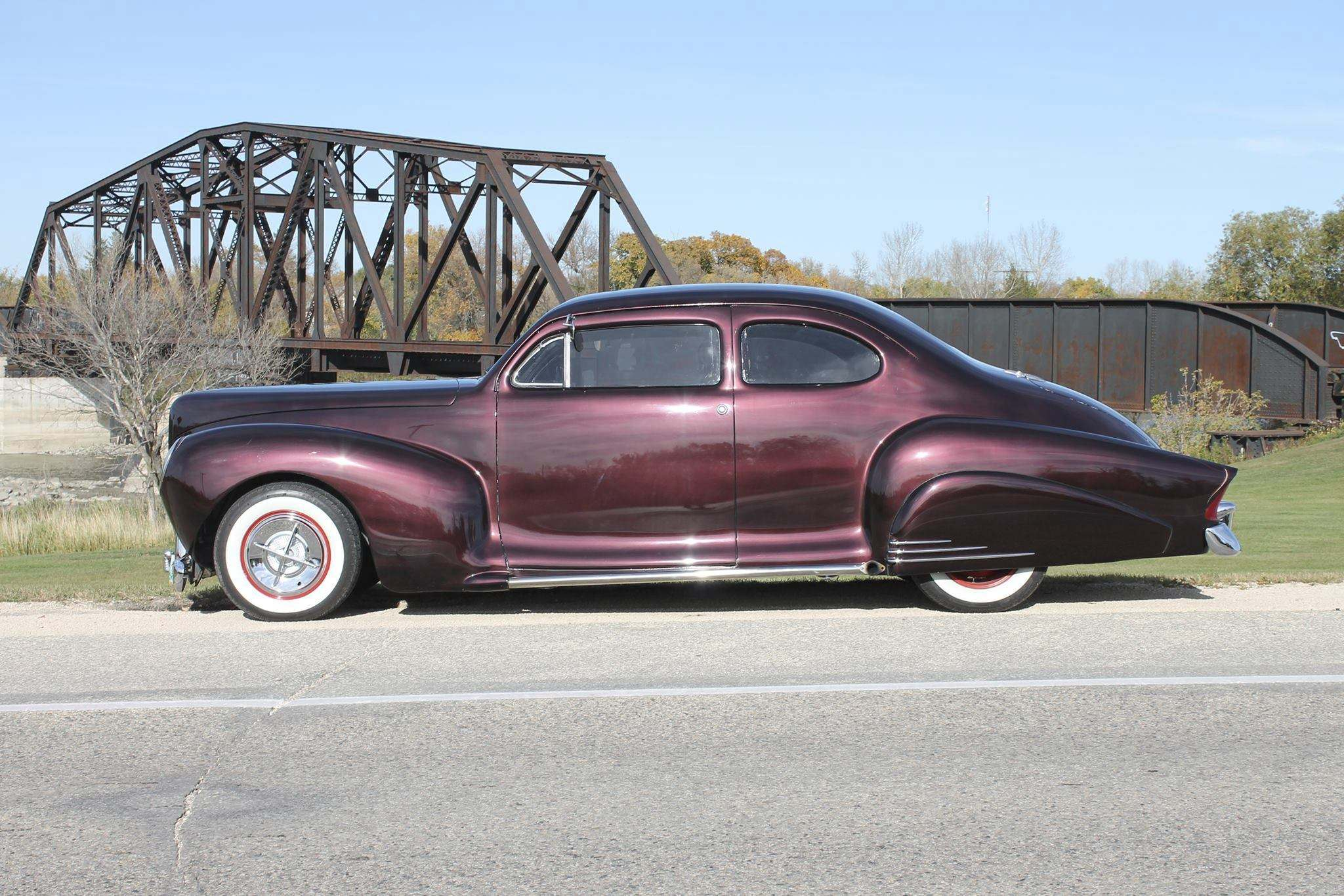 Photos by Lorne EdwardsThe car has full-fender skirts in the rear with chrome accent bars. The rear fenders were also extended to accommodate classic Packard tailamps.