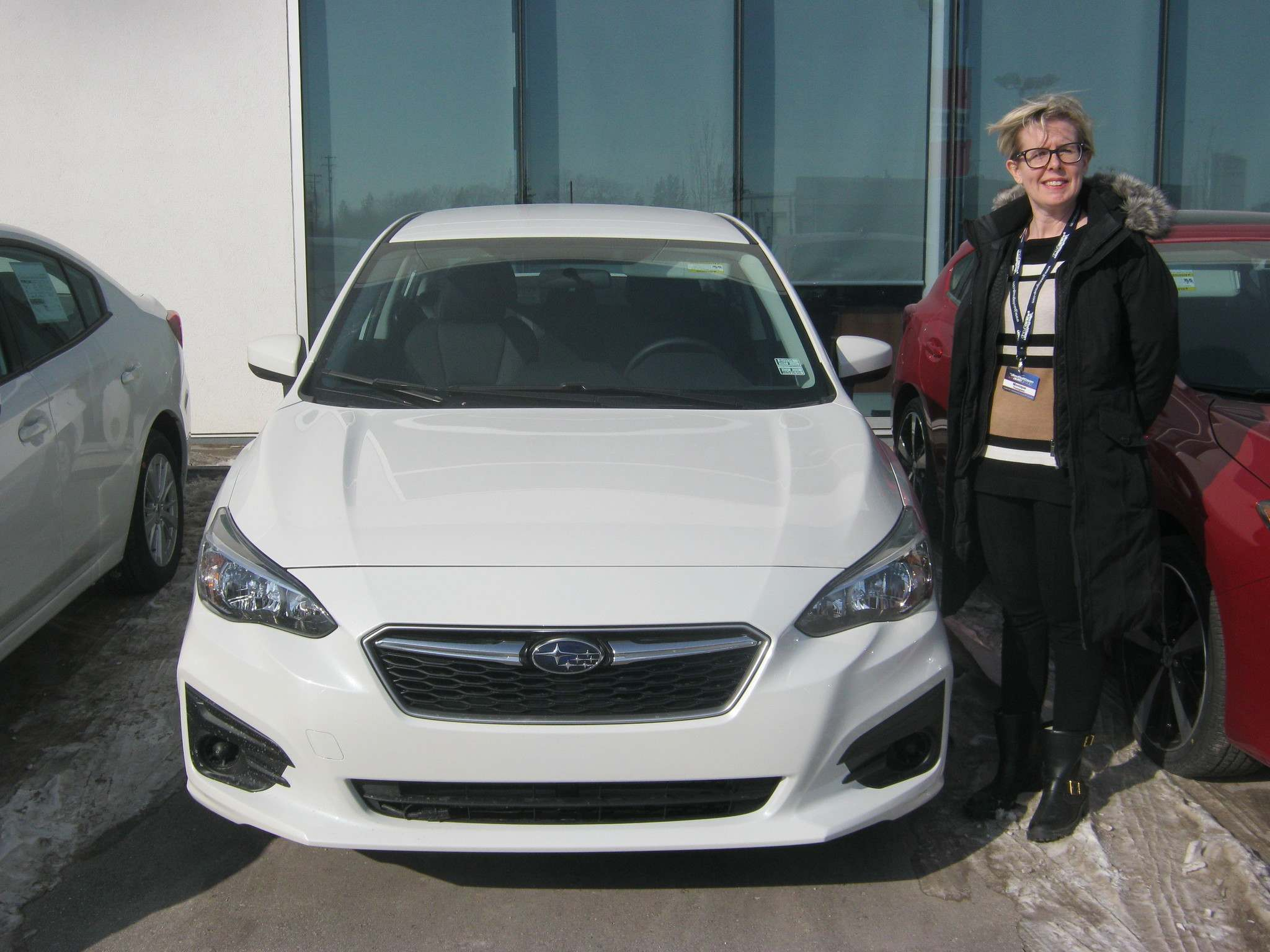 Myron Love / Winnipeg Free PressMonique Thompson, the longest serving Subaru product advisor in the Prairie Provinces, stands by the 2017 Subaru Impreza.