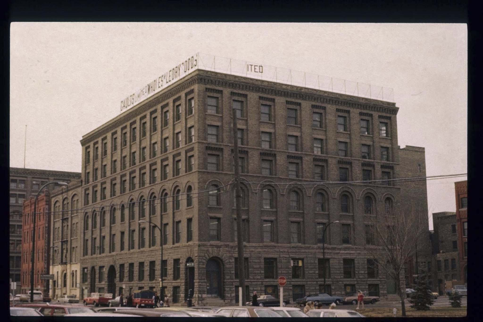 <p>An undated photo of the building's exterior that shows the 1903 six-storey extension to the south side, and two-storey addition to the top of the original building.