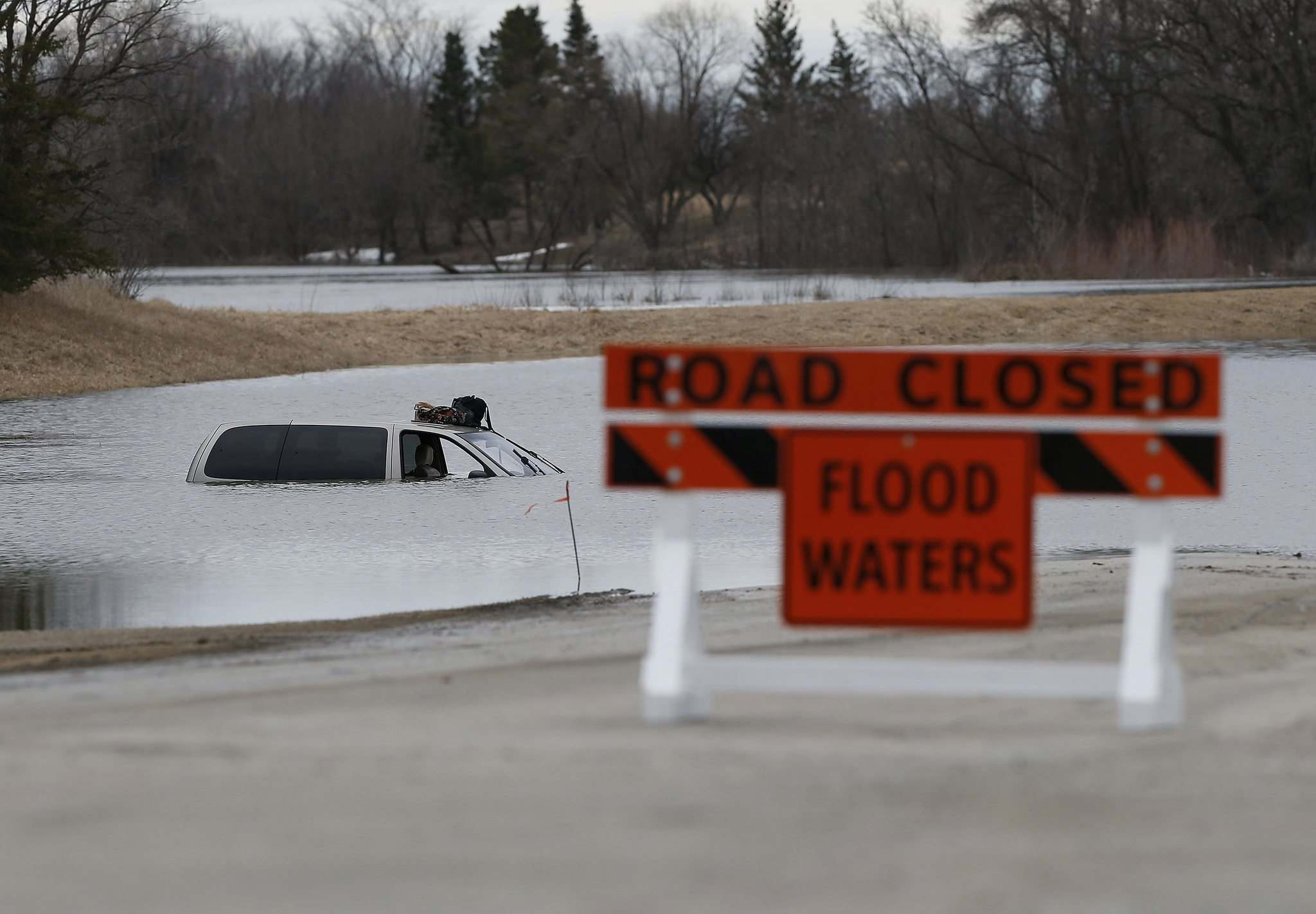 JOHN WOODS / WINNIPEG FREE PRESS</p><p>Red River Drive at Marchand Road in the R.M. of Richot had road closures due to water over the road on Sunday.</p>