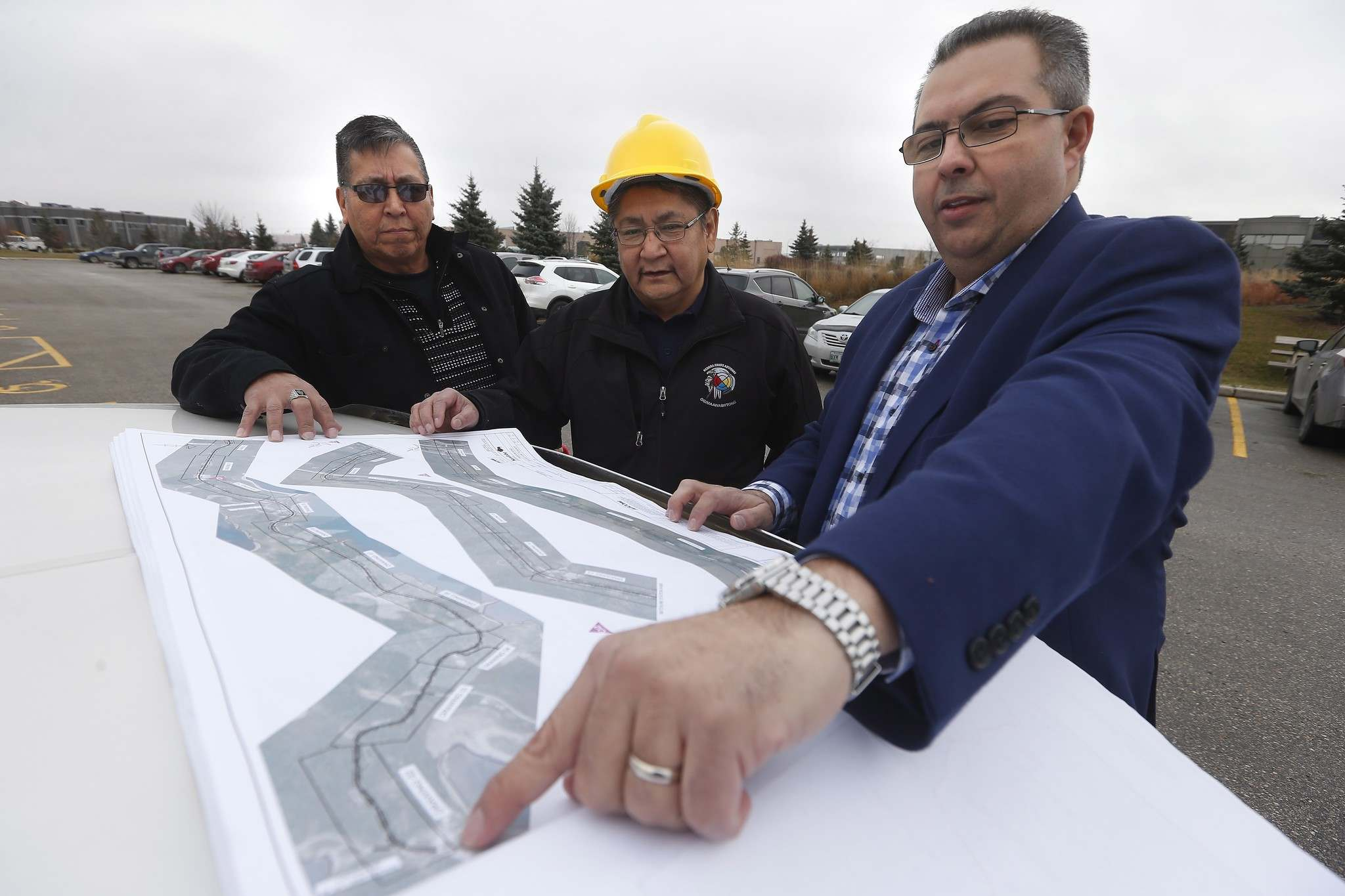 JOHN WOODS / CANADIAN PRESS FILES</p><p>Daryl Redsky, left, go over the final design drawings for Freedom Road in November 2016.</p>