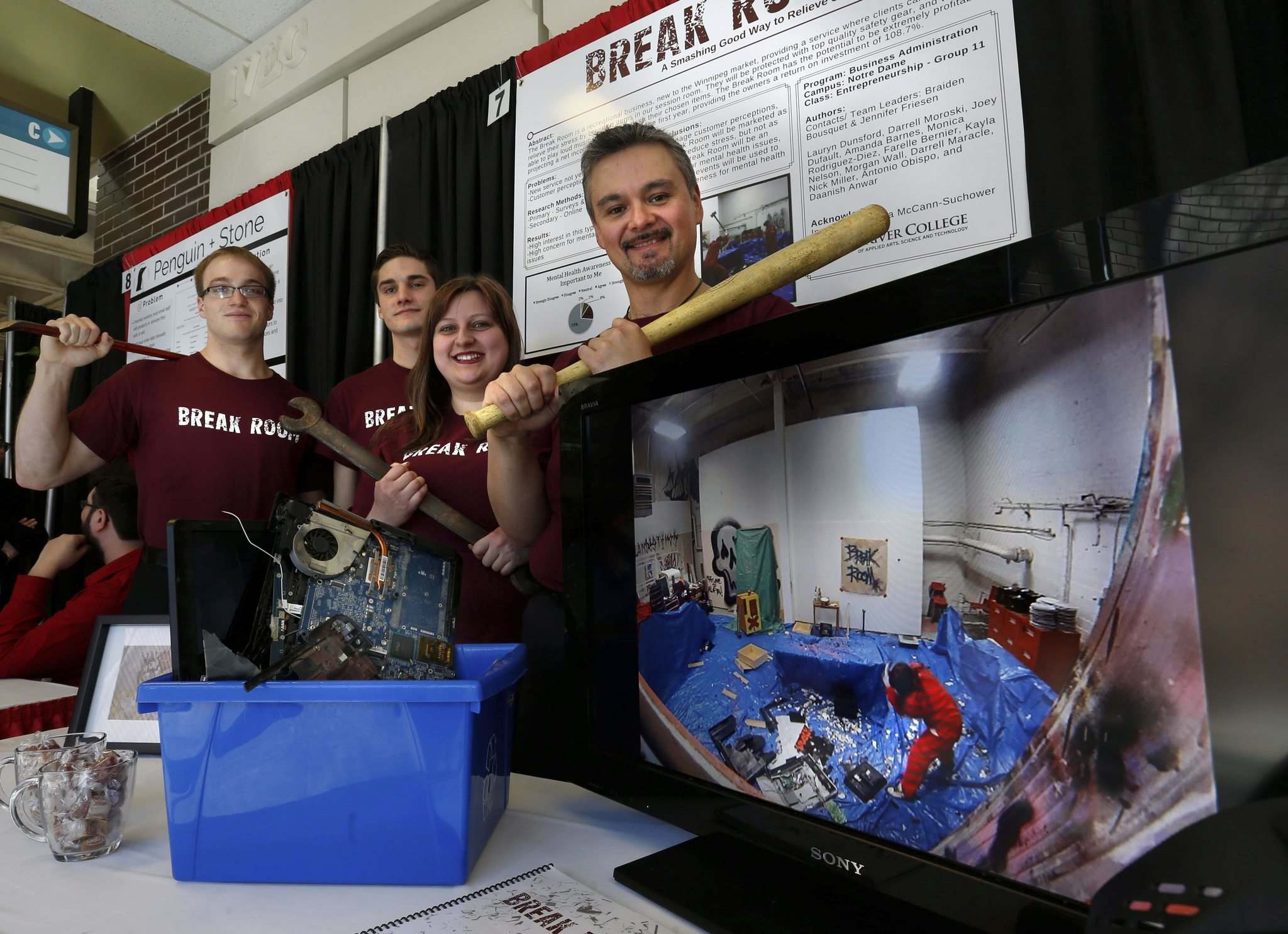 WAYNE GLOWACKI / WINNIPEG FREE PRESS</p><p>Red River students Darrell Moroski (from right), Jennifer Friesen, Braiden Bousquet and Joey Dufault are part of a team of 14 that created the Break Room, where people can relieve stress by breaking things.</p>
