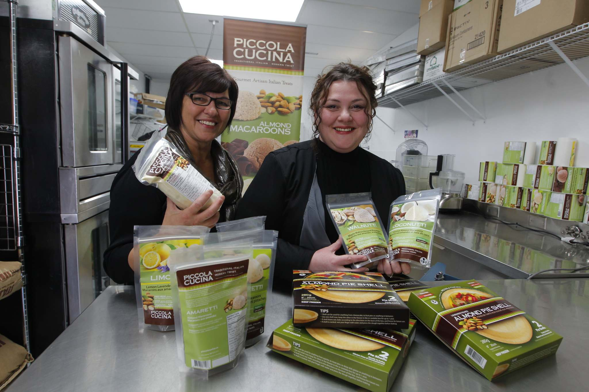 BORIS MINKEVICH / WINNIPEG FREE PRESS</p><p>Mother-and-daughter team of Anita, left, and Pina Romolo, co-owners of Piccola Cucina, a Winnipeg firm which manufacturers Italian gourmet products made from almonds.</p>