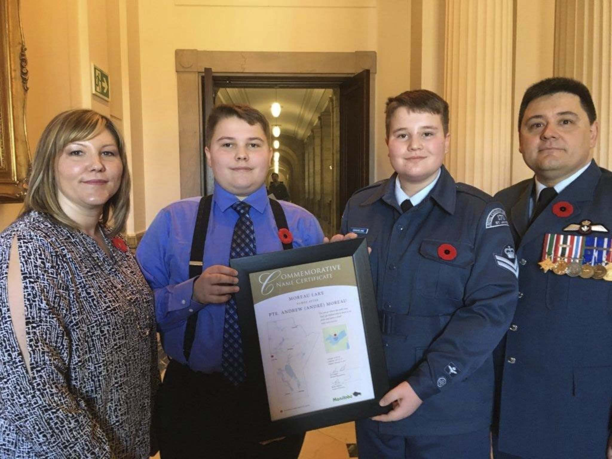 CAROL SANDERS / WINNIPEG FREE PRESS</p><p>Danielle Burr (left to right), with her son, Carson Burr, as well as nephew Ethan Graveline and brother Maj. Jason Graveline, hold a plaque commemorating their ancestor, Pte. Andrew Moreau, who fought and died in the First World War.</p></p>