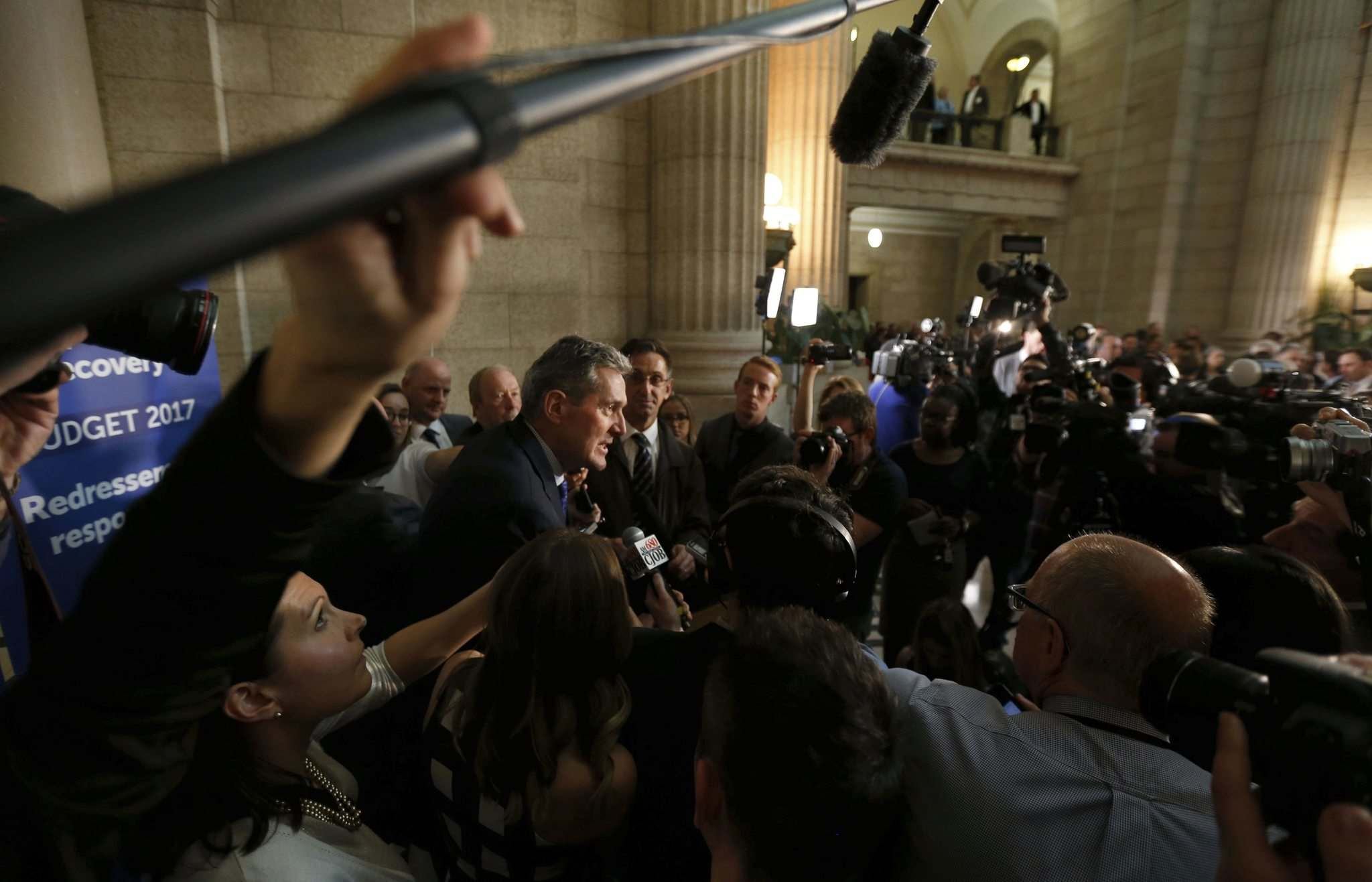 WAYNE GLOWACKI / WINNIPEG FREE PRESS FILES</p><p>Premier Brian Pallister in centre, speaks with media after the budget was delivered in the Manitoba Legislature Tuesday.</p>