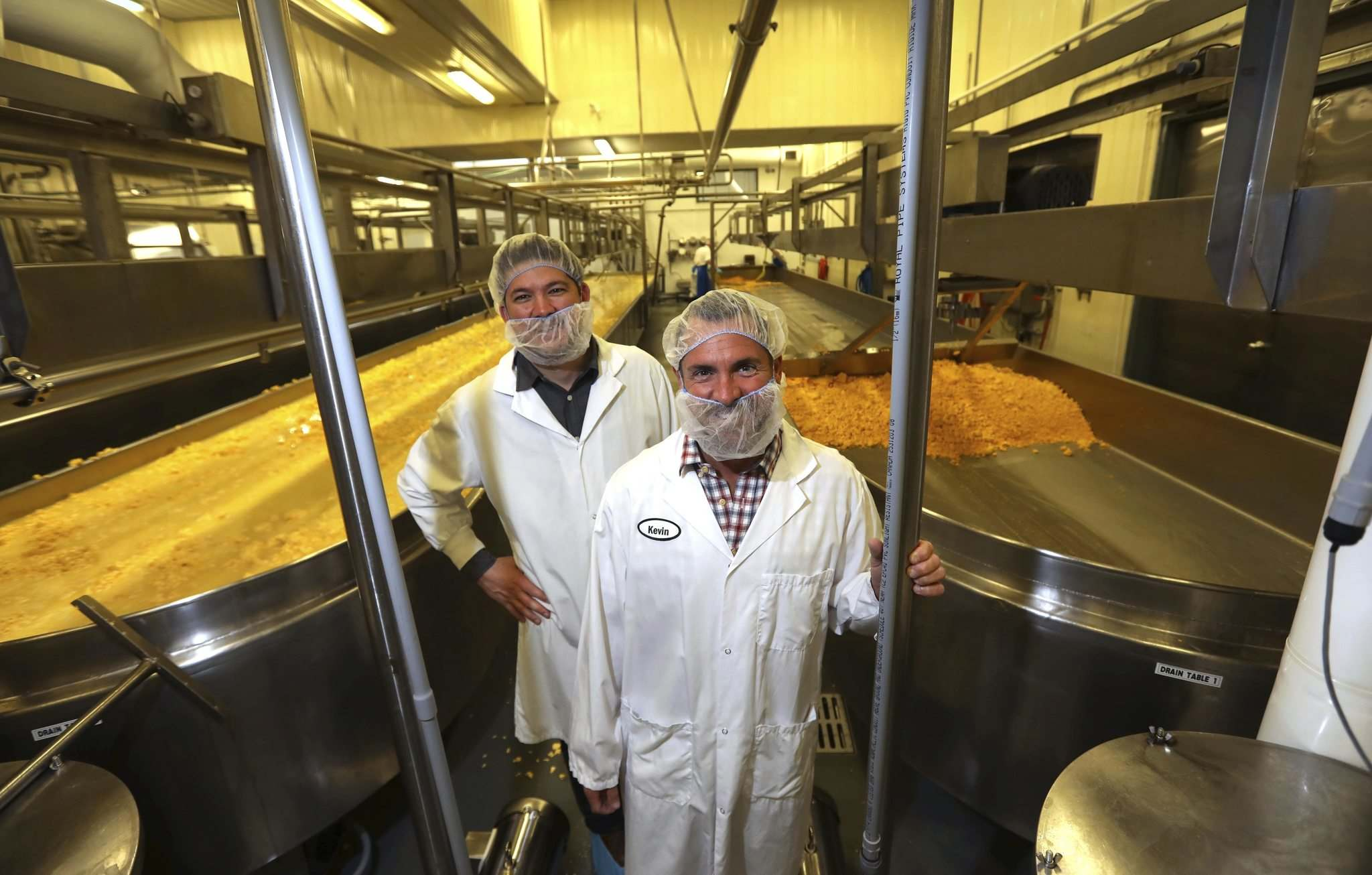 RUTH BONNEVILLE / WINNIPEG FREE PRESS</p><p>Bothwell Cheese vice-president Mike Raftis (left), pictured with president Kevin Thomson, says he believes innovation and efficiency will help the company face increased competition from European cheese.</p>