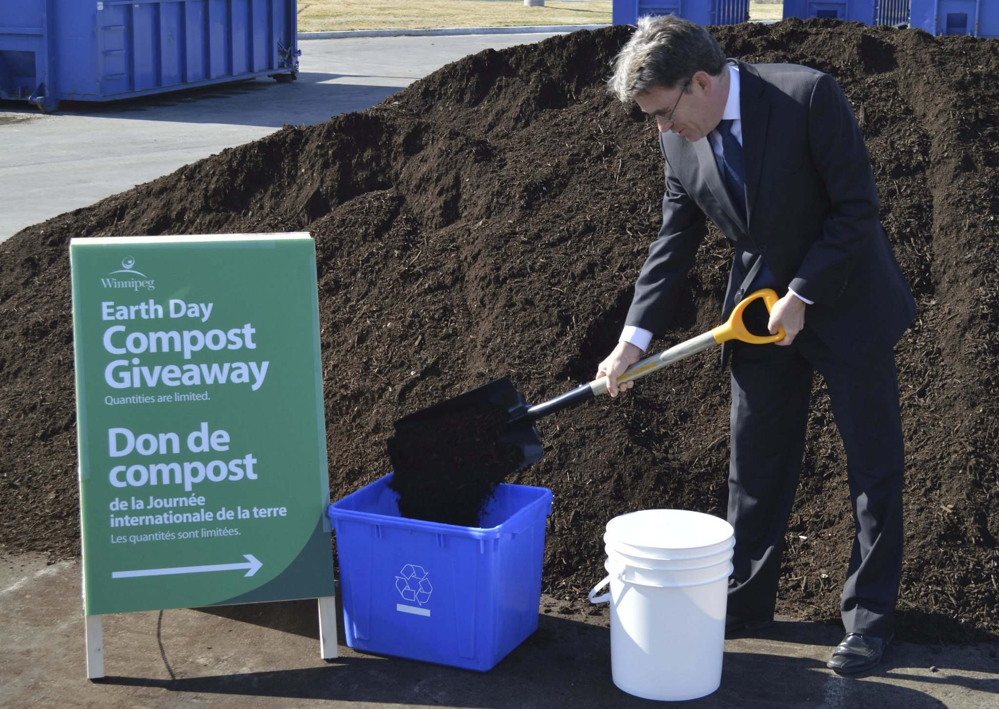 Coun. Brian Mayes shovels the first load of compost Friday at the depot on Pacific Avenue ahead of the city&rsquo;s Earth Day 2017 giveaway. </p>