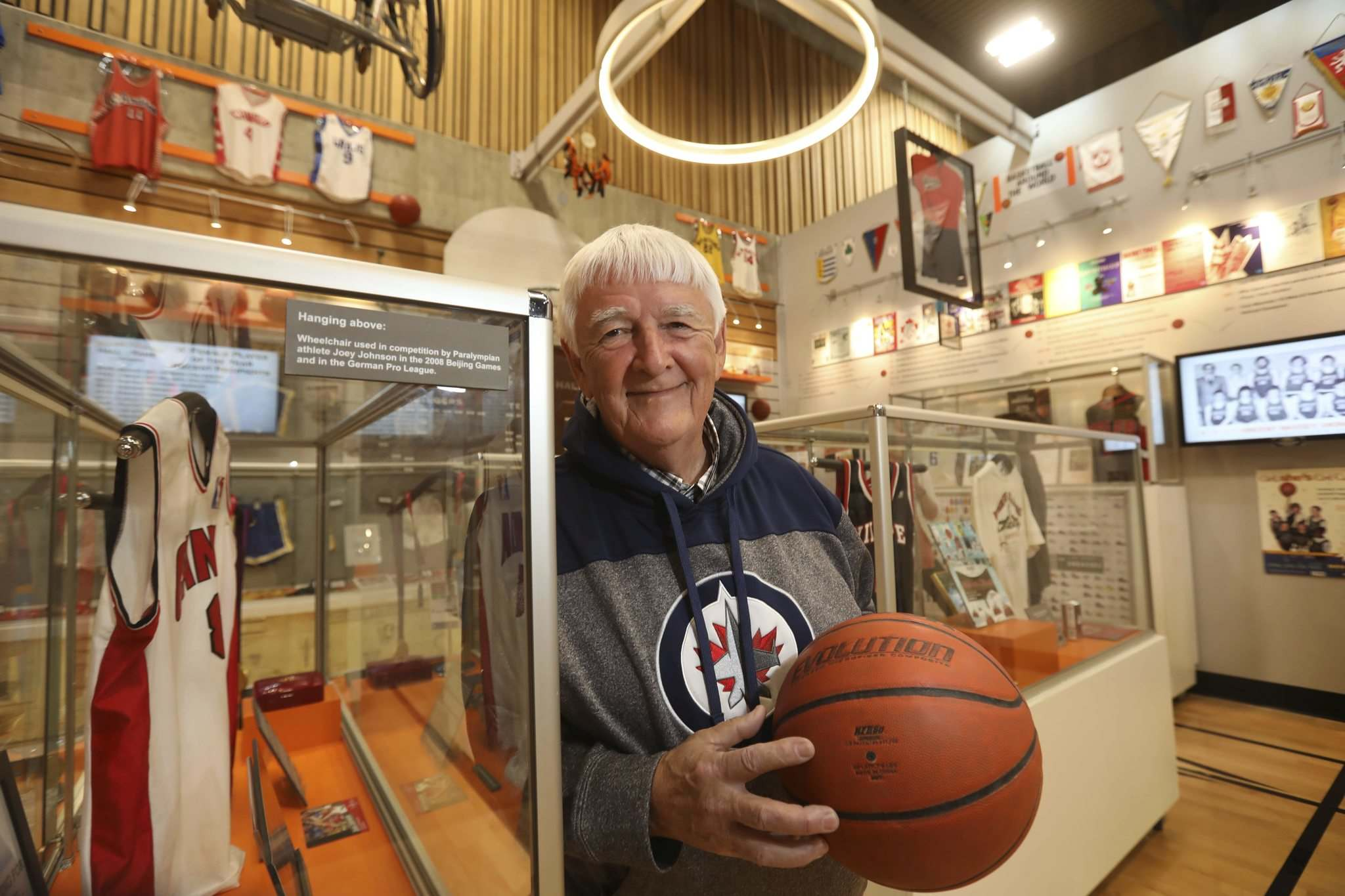 Photos by RUTH BONNEVILLE / WINNIPEG FREE PRESS</p><p>Larry Marquardson (top) is more comfortable being in the background, but the longtime coach will be front and centre as one of the inductees into the Manitoba Basketball Hall of Fame. Another supporter of basketball in the province, the late Dennis Alvestad, will also be inducted. He was represented by his widow, Betty Butler, at Tuesday's announcement.</p>