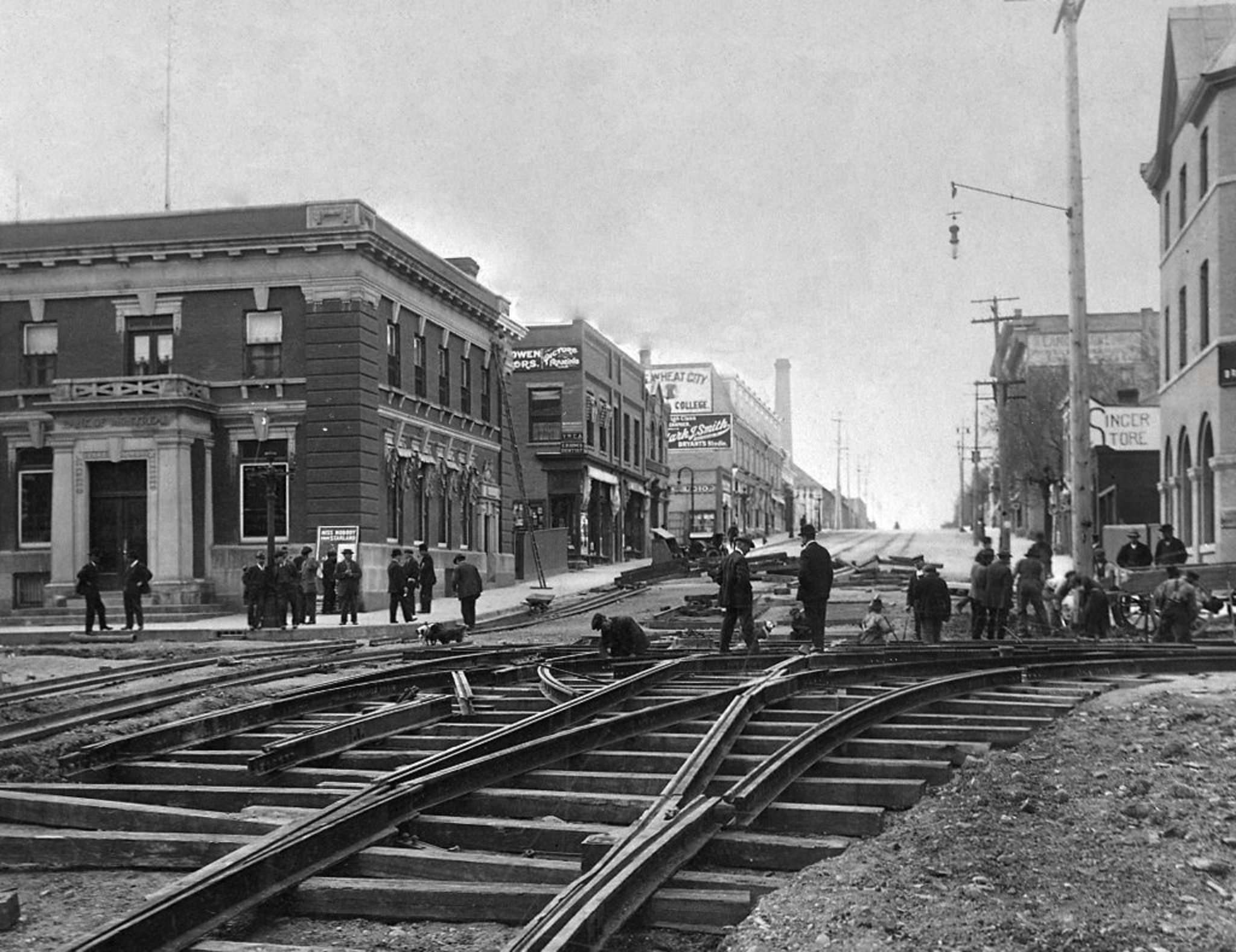 <p>Looking south at the intersection of 10th Street and Rosser Avenue. Work on the street railway was in full swing by the summer of 1912. </p>