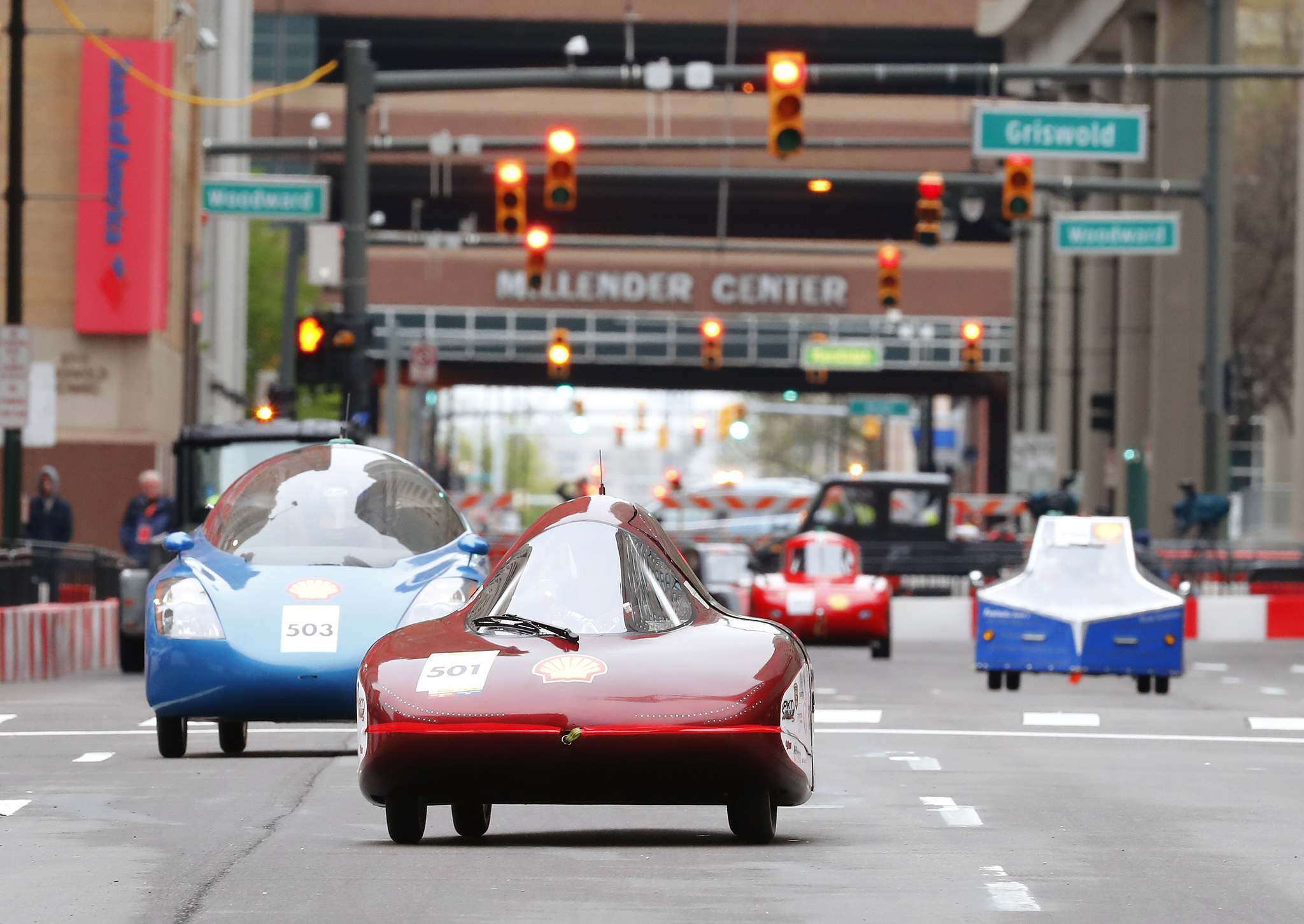 Rick Osentoski / The Associated Press filesThe Elroy (second from left), a gasoline urban concept vehicle racing for team Mater Dei Supermileage, leads a pack of cars on the track during the final day of the Shell Eco-marathon Americas 2017 at the Cobo Center in Detroit.