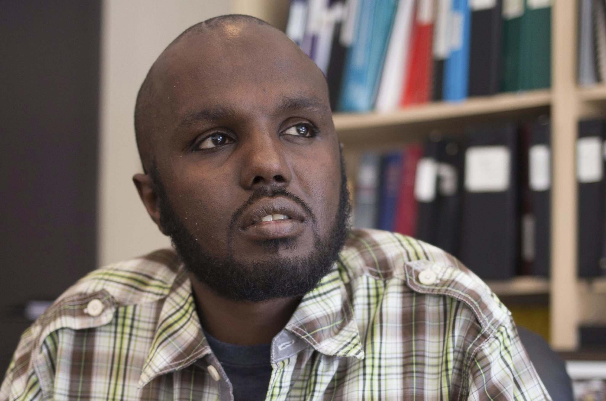 JEN DOERKSEN / WINNIPEG FREE PRESS</p><p>Ahmed Aden Ali, 37, is waiting to get a work permit so he can support himself while his immigration application is considered. He also volunteers as an interpreter at the inner-city shelter where he lives.</p></p>