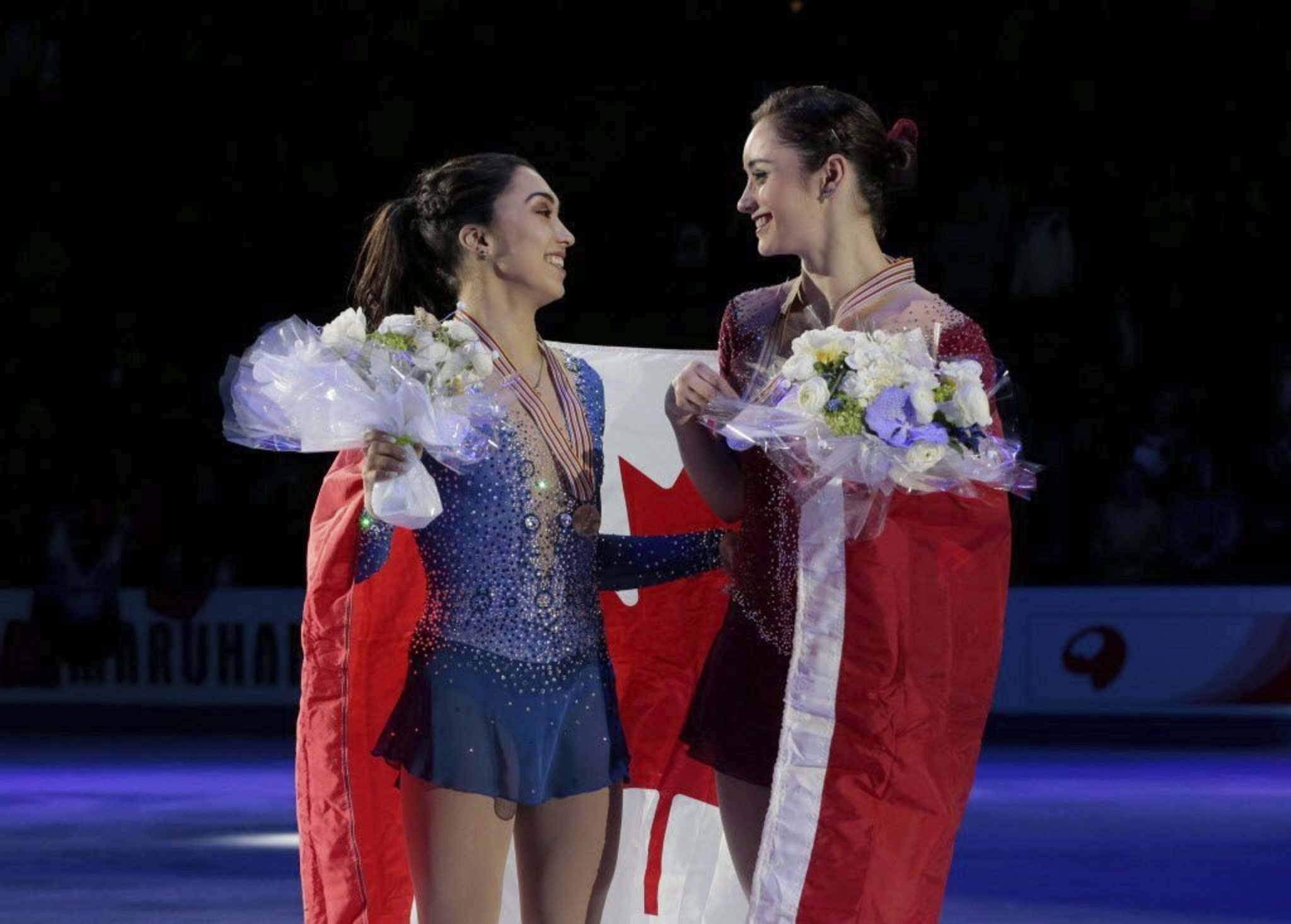 Ivan Sekretarev / The Associated Press Files</p><p>Kaetlyn Osmond (right) and Gabrielle Daleman, both of Canada, smile posing with their silver and bronze medals and the national flag during victory ceremony at the World figure skating championships in Helsinki, Finland, on Friday, March 31, 2017.</p>