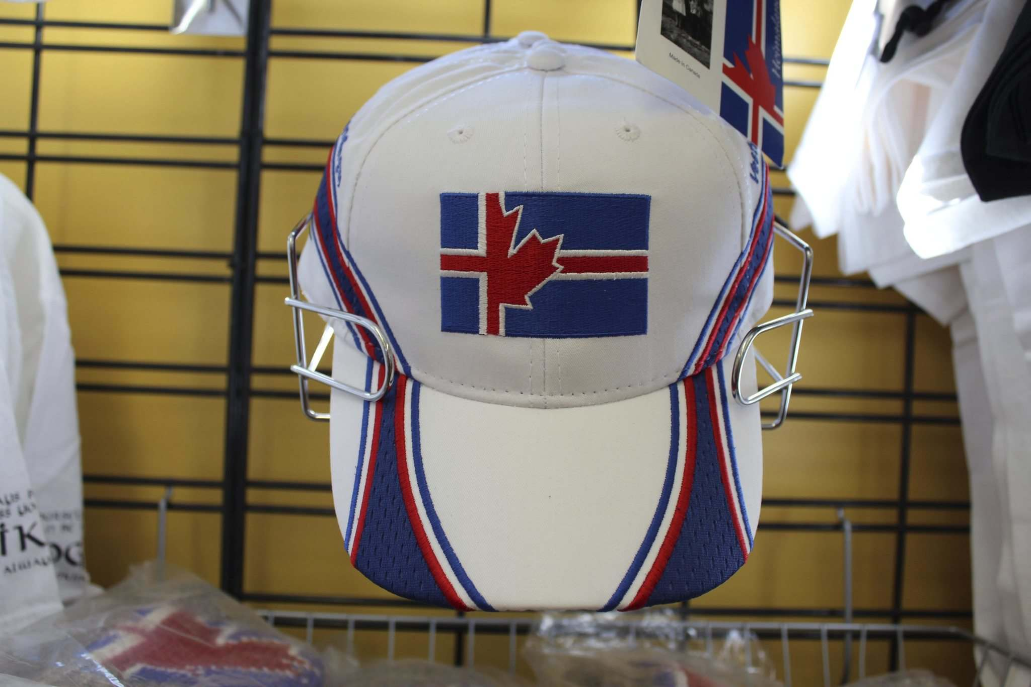 An Icelandic-Canadian (or Canadian-Icelandic) ballcap, emblazoned with the hybrid logo designed by Donna Austfjord, is one of Hnausa General Store's more unique items.