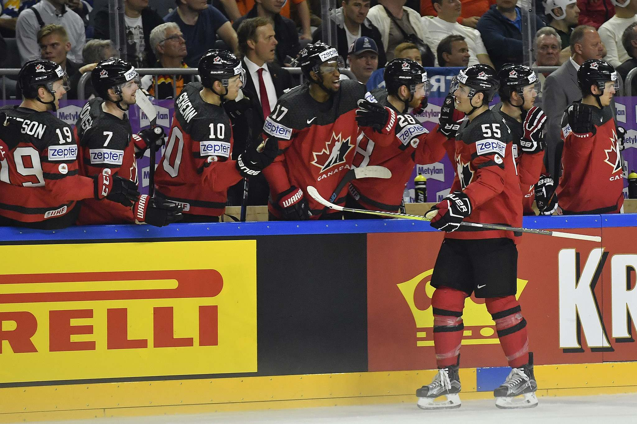 Canada&#39;s forward Mark Scheifele celebrates with team mates after scoring his side&#39;s opening goal at the Ice Hockey World Championships quarterfinal match between Canada and Germany in the LANXESS arena in Cologne, Germany, Thursday, May 18, 2017. (AP Photo/Martin Meissner)</p>