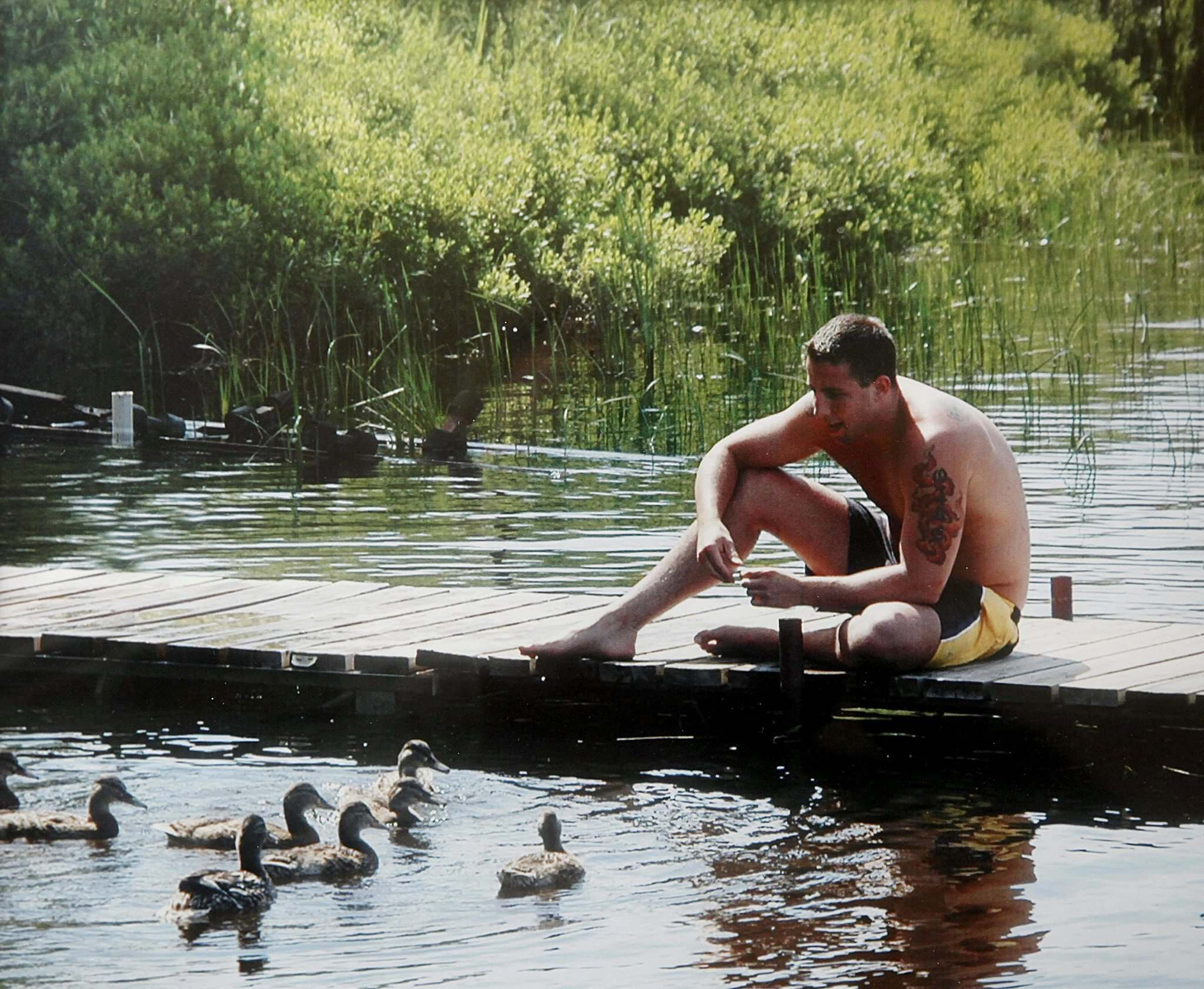 <p>Bruce Oake feeds ducks in this family snapshot.  (Submitted)</p>