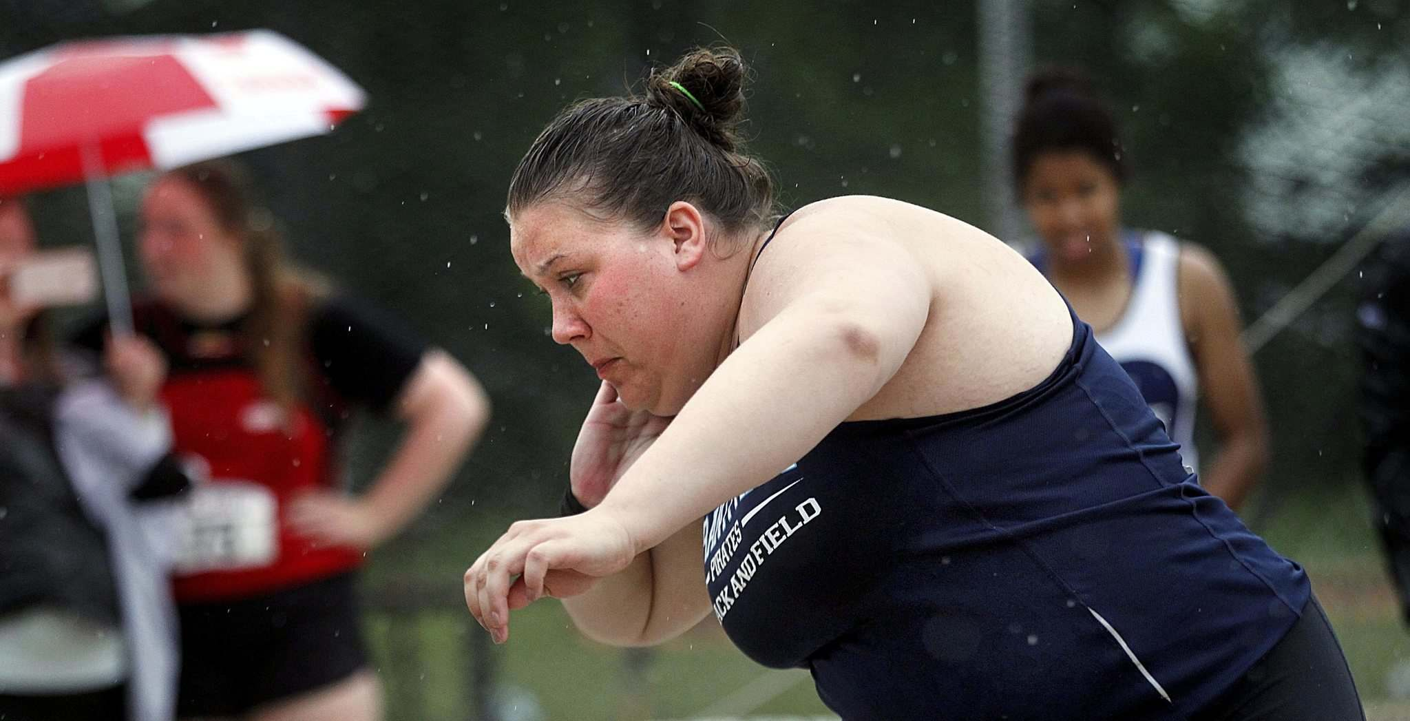 PHIL HOSSACK / WINNIPEG FREE PRESS</p><p>Taylor Heald didn't let the rain stop her Friday. The Grant Park Pirate tied the provincial high school record in shotput set almost 30 years ago.</p>