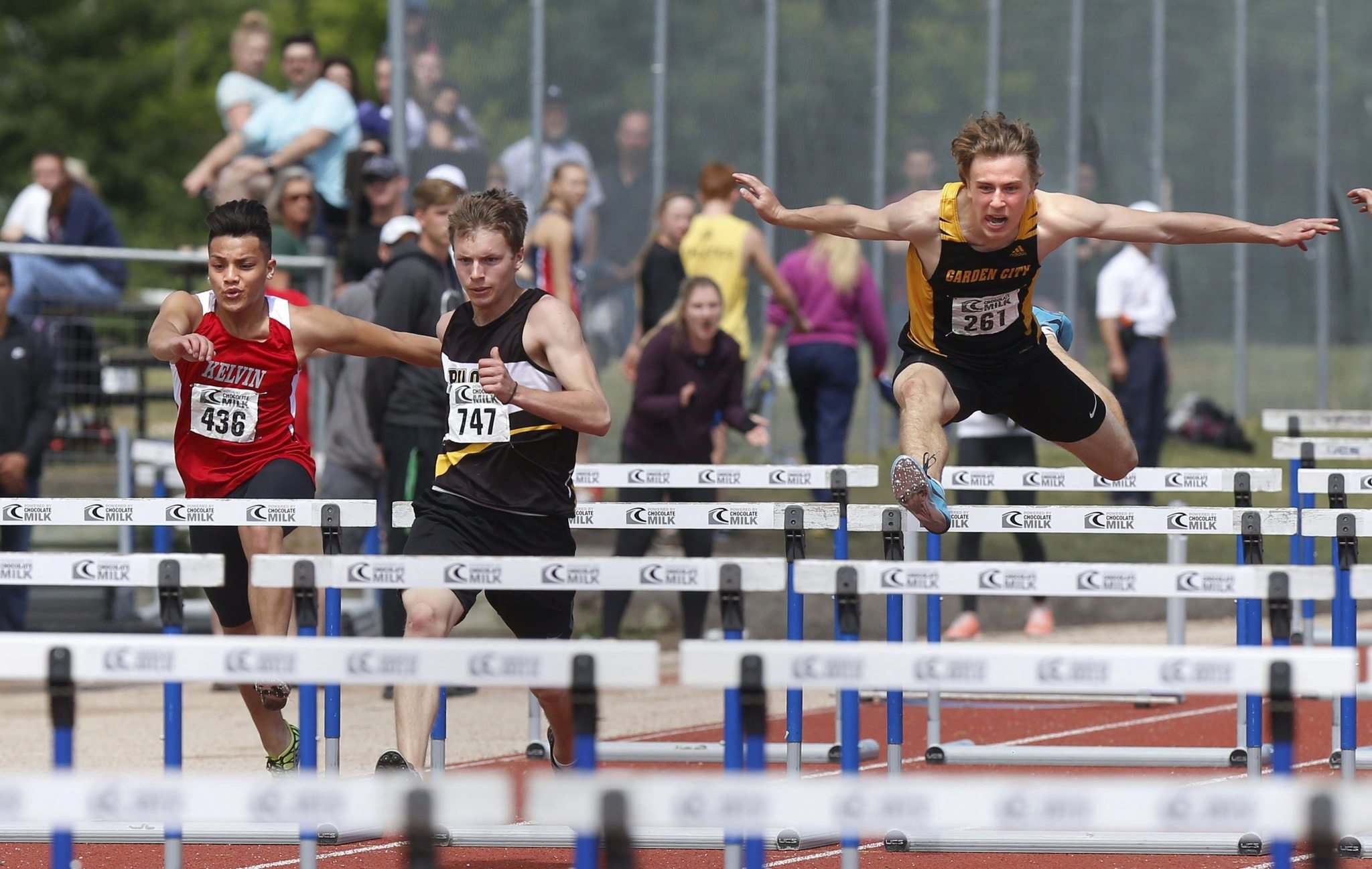 WAYNE GLOWACKI / WINNIPEG FREE PRESS</p><p>From left: Cyril Hernandez from Kelvin High School, Luke VanDamme from Pilot Mound Collegiate and Michael Boguski from Garden City Collegiate race in the varsity boys 100-metre hurdles event at the Provincial High School Milk Track and Field Championship at the University of Manitoba Stadium Saturday.</p>