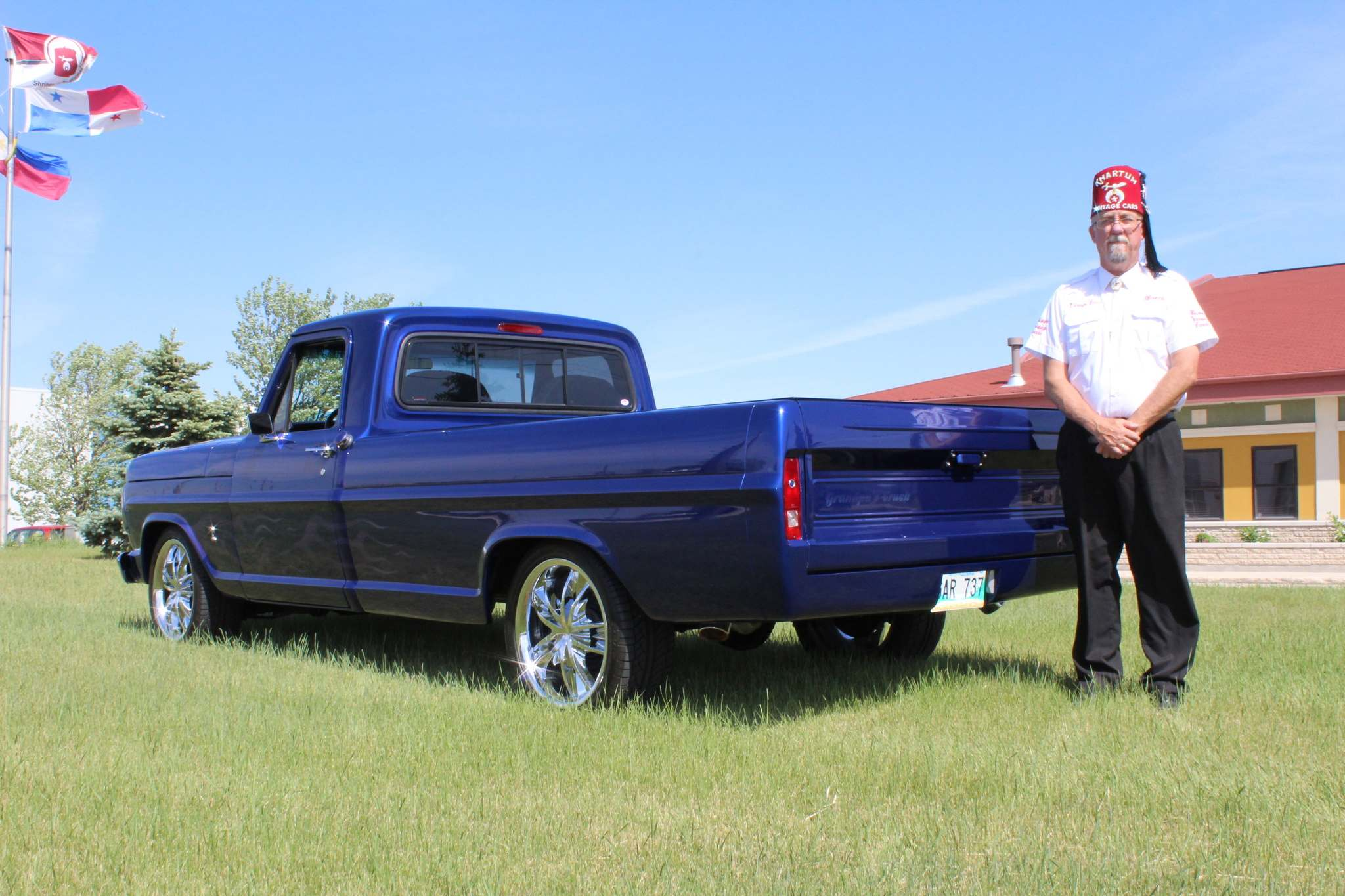 PHOTOS BY Larry D'Argis / winnipeg free press Khartum Shriners noble Brent Gillespie shows off the restored 1967 Ford F100 valued at $32,000 that is the prize for the group's annual charity raffle.