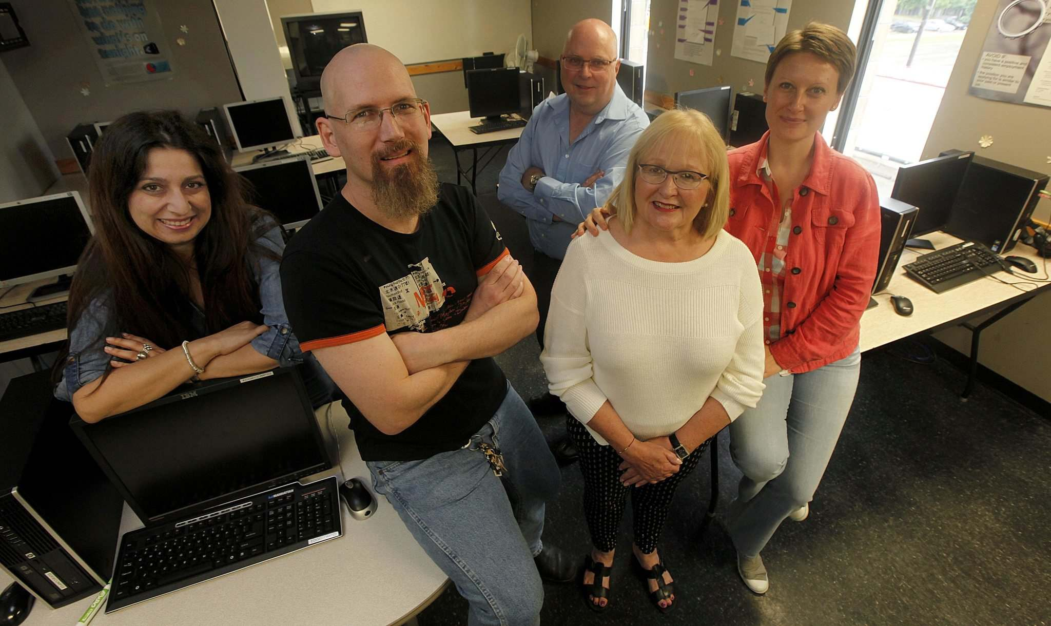 PHIL HOSSACK / WINNIPEG FREE PRESS</p><p>Toula Papagiannopoulos (from left), Jason Hussey, Miles Murphy, Joan Embleton and Elena Cvetkovska help out at Edge Skills Centre.</p>