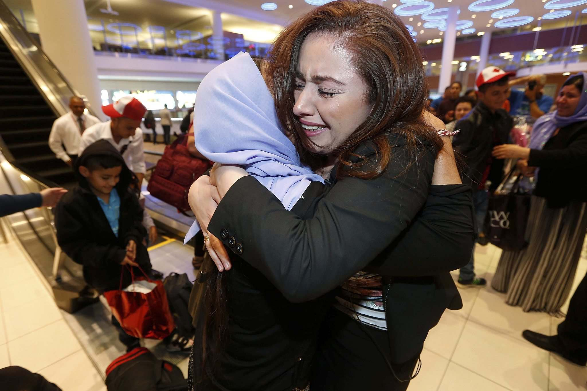 JOHN WOODS / WINNIPEG FREE PRESS FILES</p><p>Nafiyo Naso welcomes relatives at Richardson International Airport last year. Several of the first Yazidi refugees to arrive in Winnipeg under Operation Ezra were related to Naso. </p>