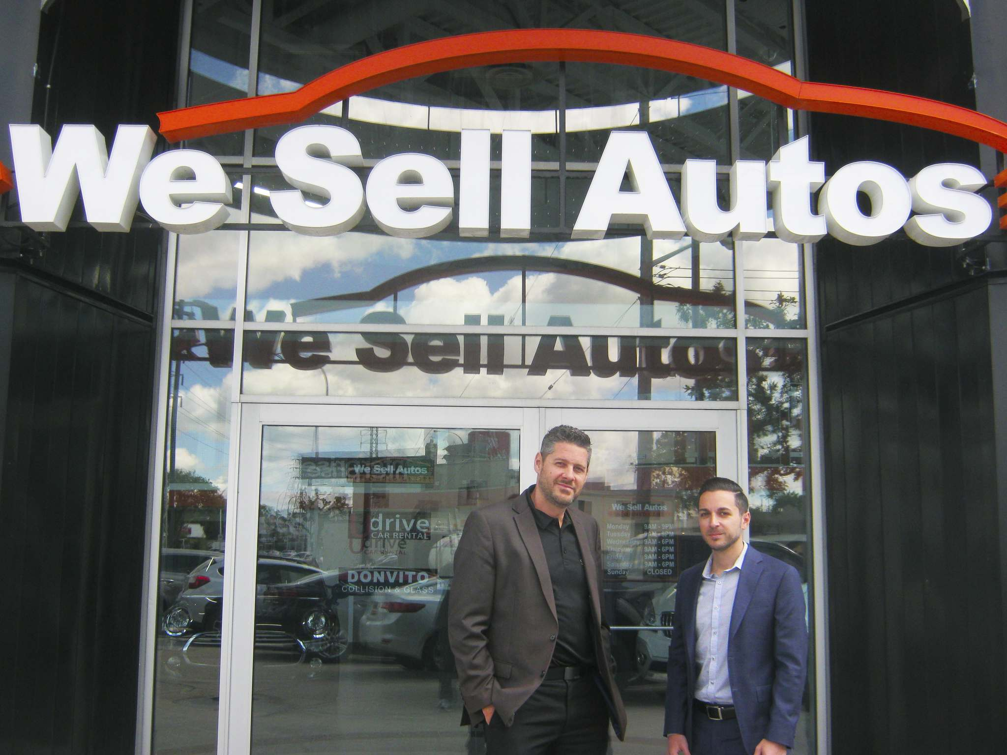 Myron Love / Winnipeg Free PressChris Dyck (left) and Paul Donvito outside their new We Sell Cars store.