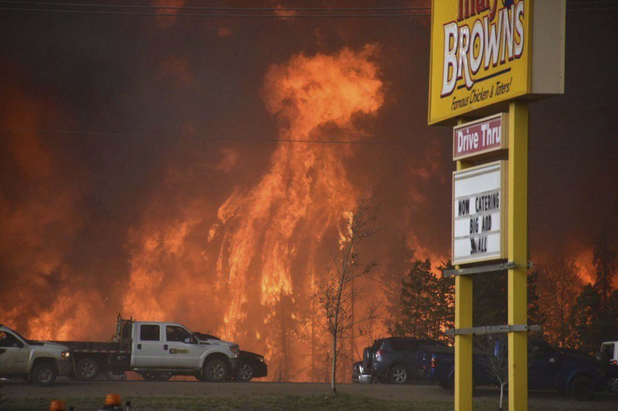 Terry Reith / The Canadian Press files</p><p>A wall of fire rages outside of Fort McMurray, Alta., in this May 2016 photo.</p>