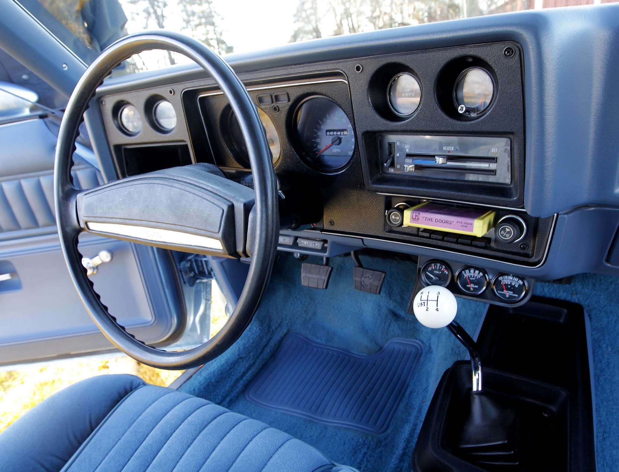 Dash includes an 8-track player complete with a Doors tape.