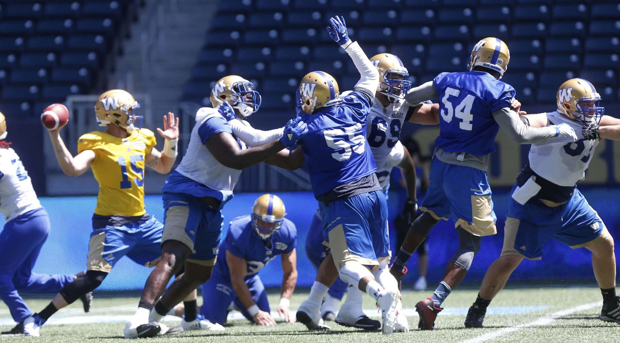 The Bombers' defensive line puts pressure on QB Matt Nichols during practice at Investors Group Field Wednesday in preparation for Friday's home opener against Calgary. (Wayne Glowacki / Winnipeg Free Press)</p>