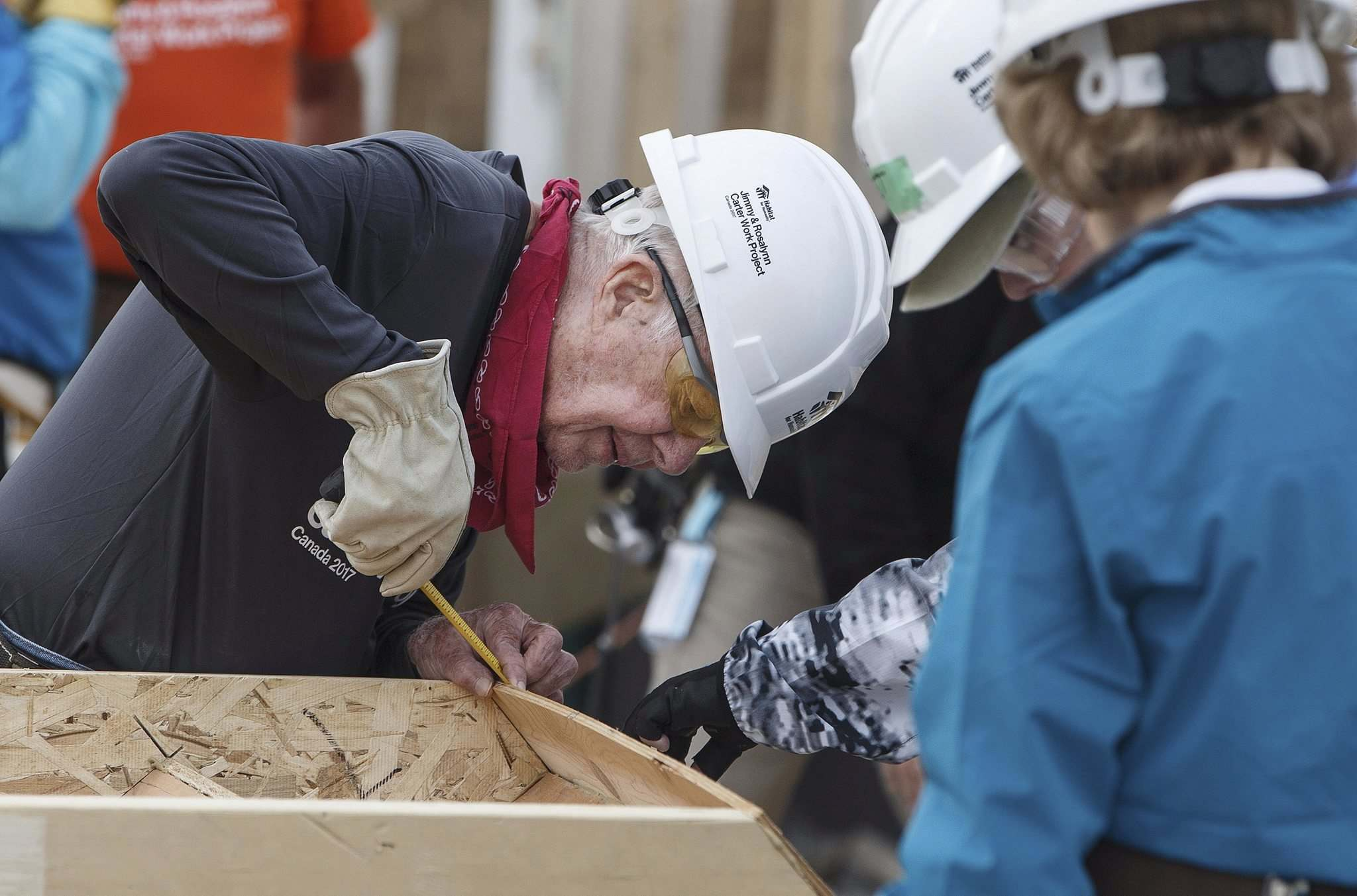 JASON FRANSON  THE CANADIAN PRESSFormer U.S. president Jimmy Carter measures a set of stairs as he helps build homes for Habitat for Humanity in Edmonton Tuesday