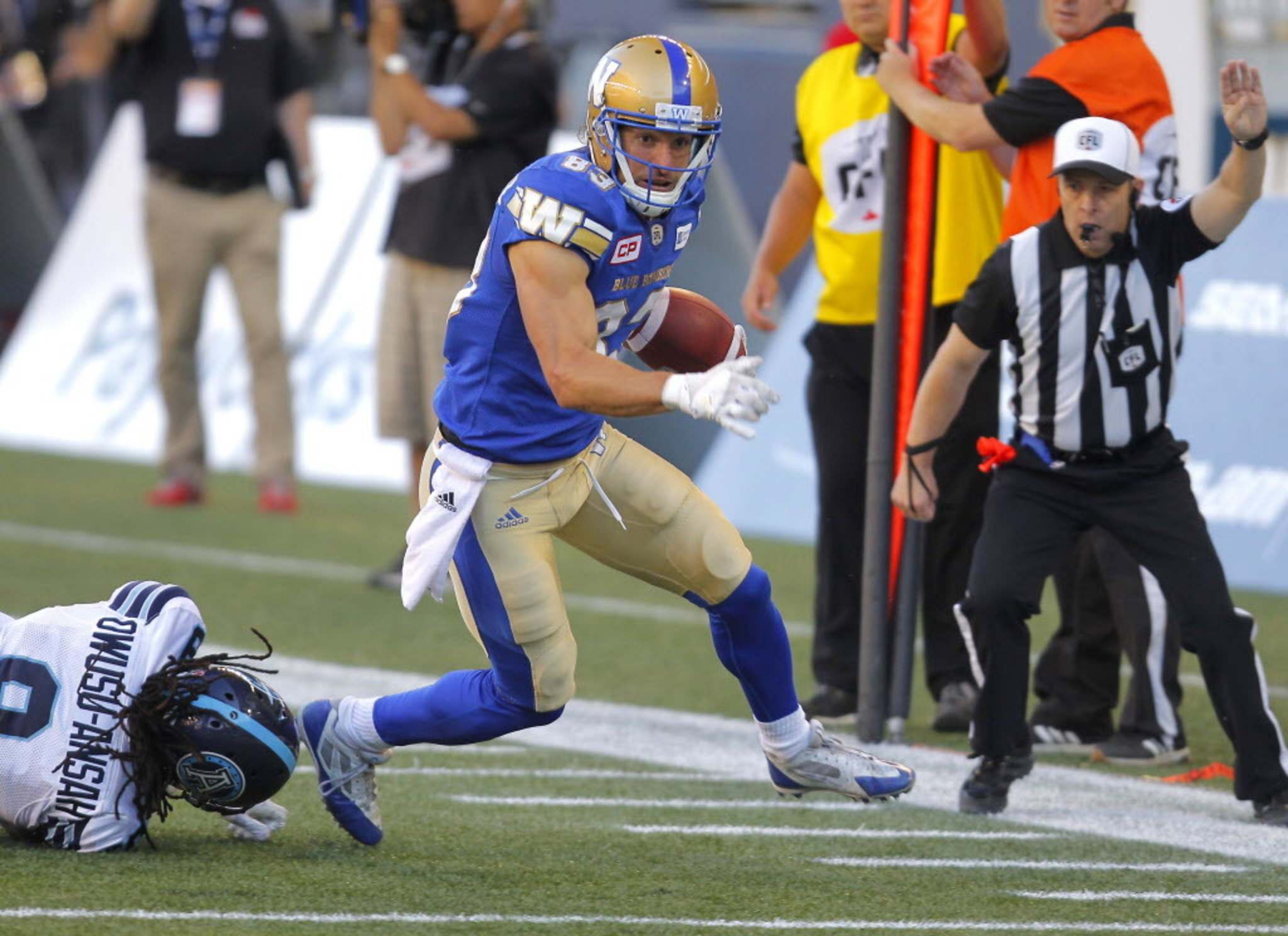 BORIS MINKEVICH / WINNIPEG FREE PRESS</p><p>Winnipeg Blue Bombers Julian Feoli-Gudino gets some yards after the catch in game against the Argos, Thursday.</p>