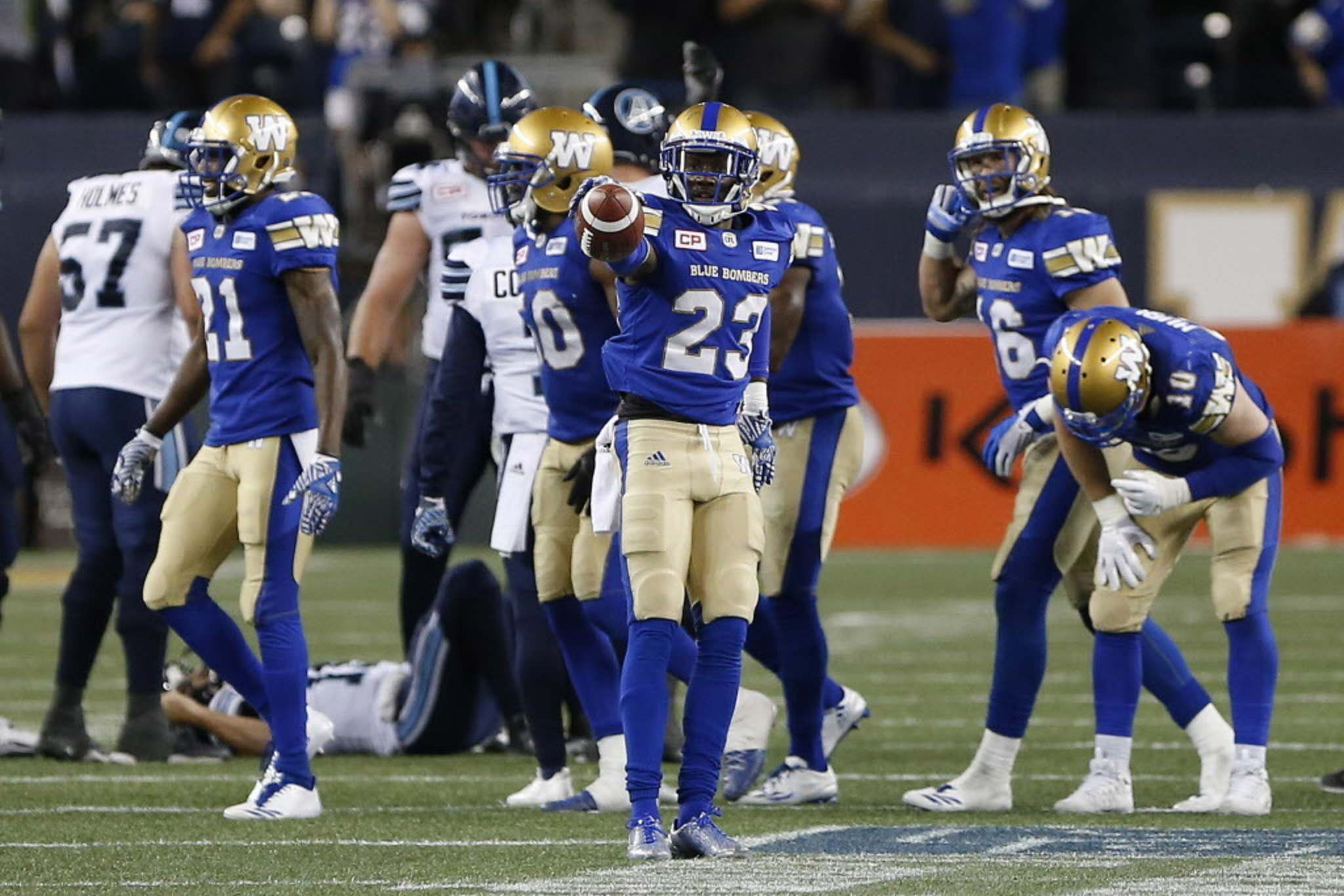 THE CANADIAN PRESS/John Woods</p><p>Winnipeg Blue Bombers' T.J. Heath celebrates his league-leading fourth interception of the season during second half CFL action against the Toronto Argonauts in Winnipeg, Thursday.</p>