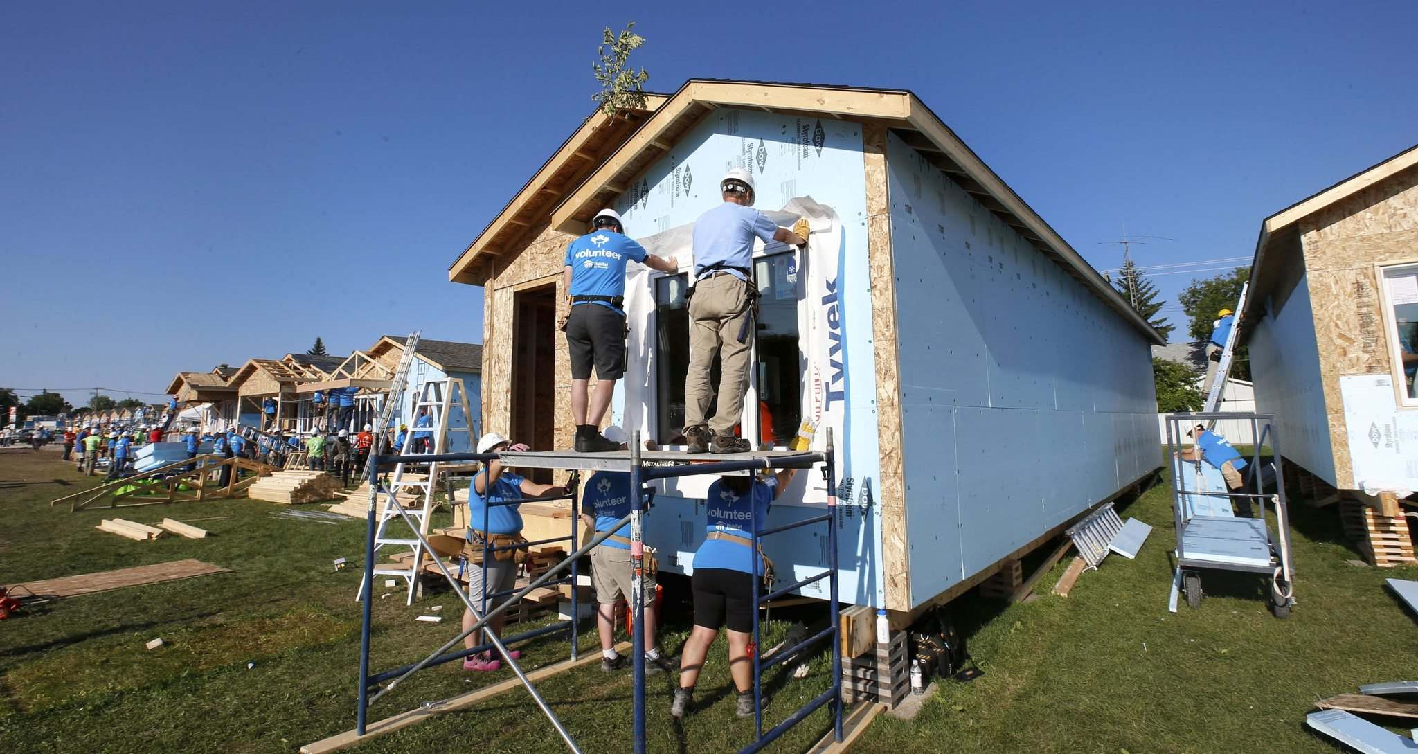 WAYNE GLOWACKI / WINNIPEG FREE PRESS</p><p>Volunteers were back at it Friday morning finishing up homes on Lyle St. for the Habitat for Humanity&rsquo;s 34th Jimmy &amp; Rosalynn Carter Work Project.</p>