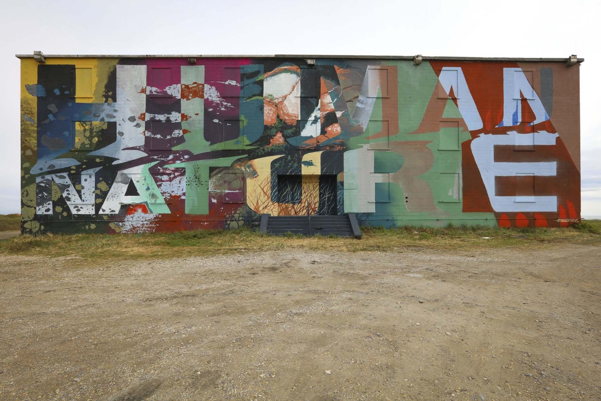 New Zealander Askew One titled his mural on the Omnitrax port residence Human Nature. (Tre Packard photo)</p>