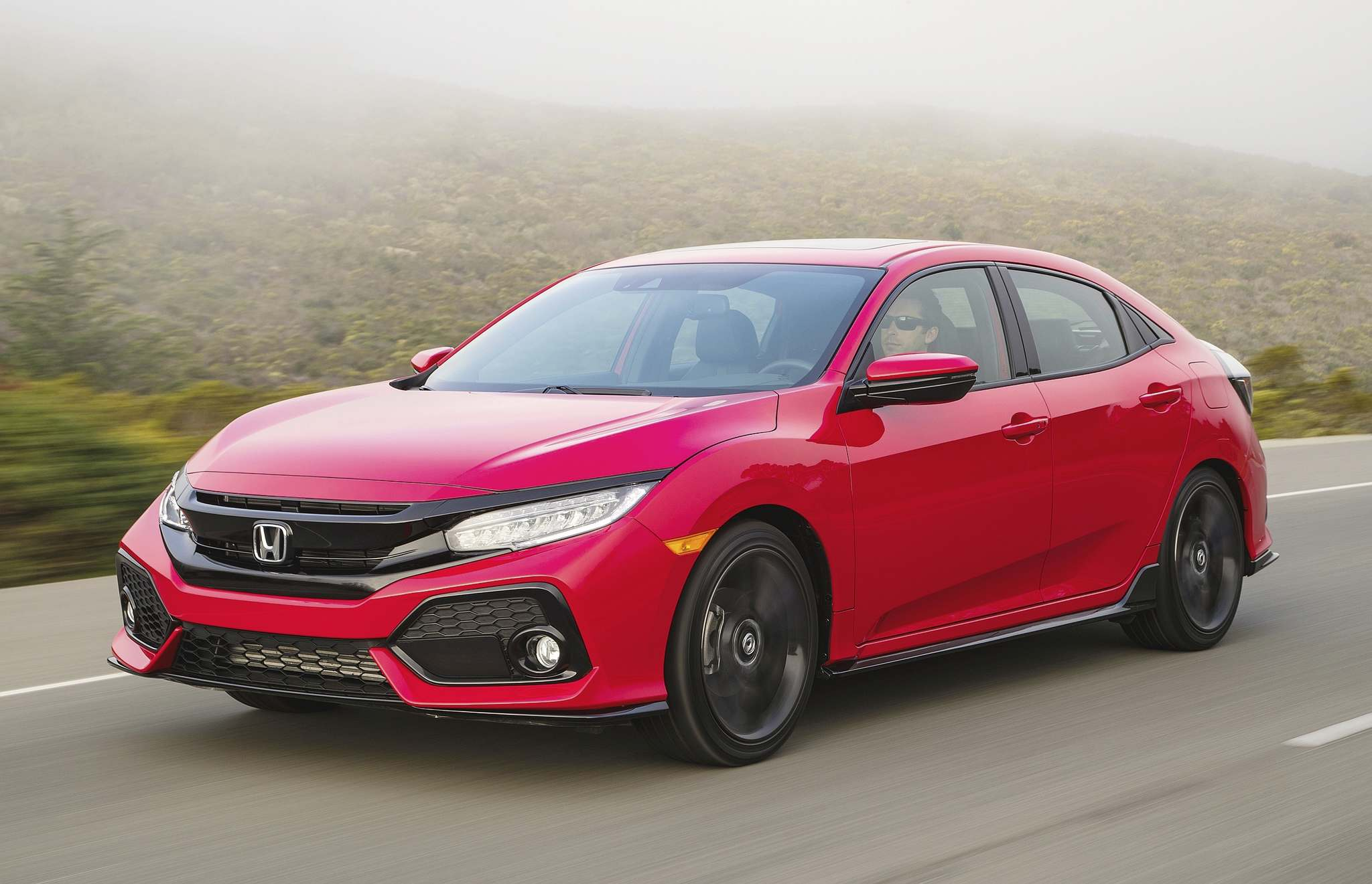 HondaThe 2017 Honda Civic hatchback is a joy to drive and, with up to 1,300 litres of cargo space, easily trounces the sedan.