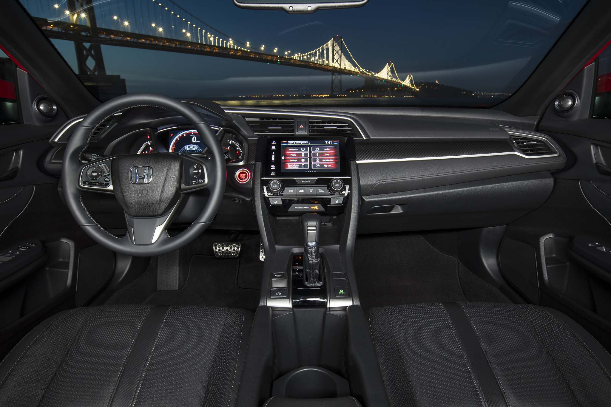 HondaThe interior of the 2017 Honda Civic Hatchback Sport Touring has a logical control layout and tasteful treatments of the upholstery and trim.