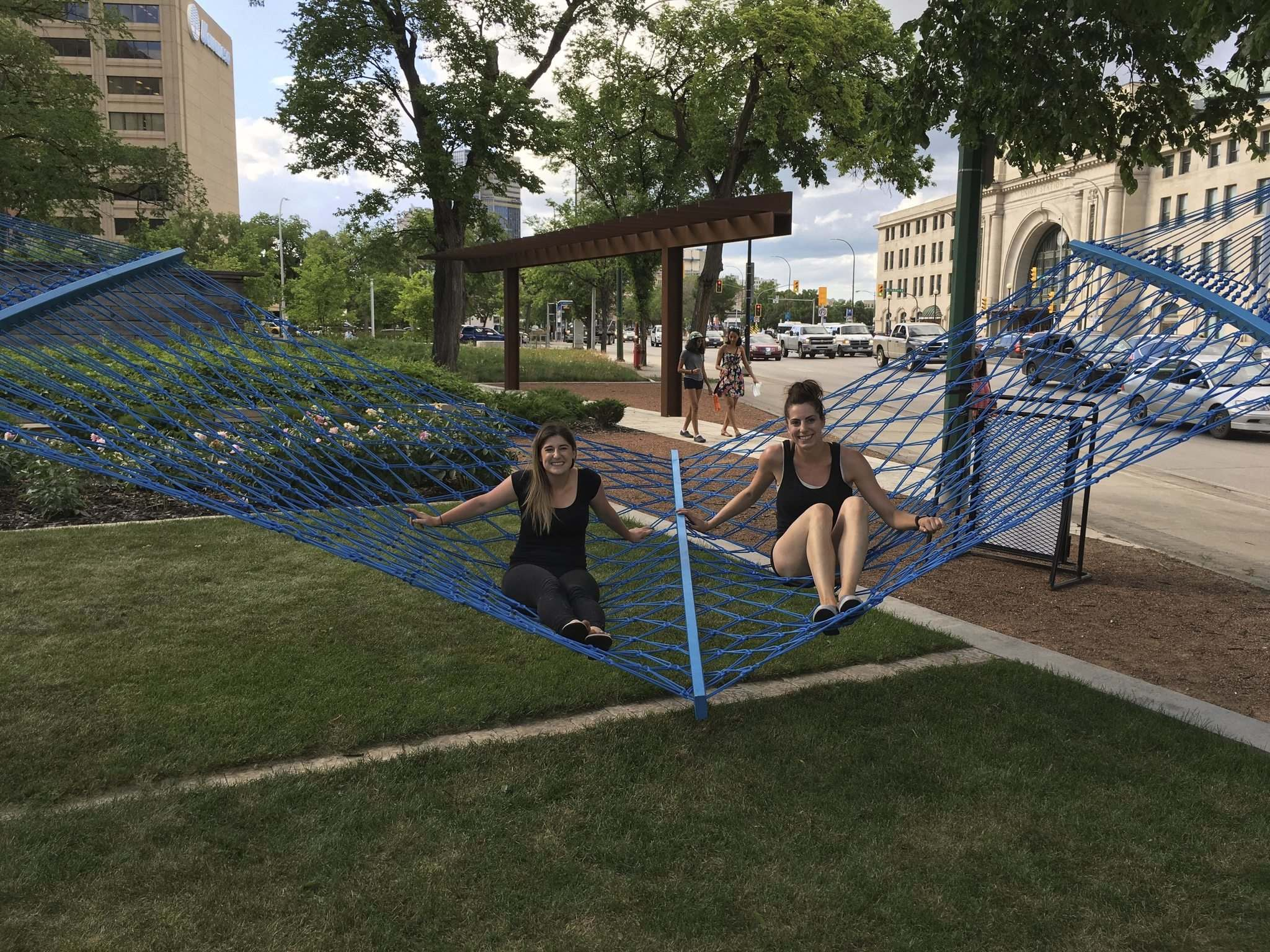 SUPPLIED</p><p>Landscape architects Rachelle Kirouac (left) and Danielle Loeb of HTFC Planning &amp; Design enjoy the giant hammock portion of their installation, the Weave.</p>