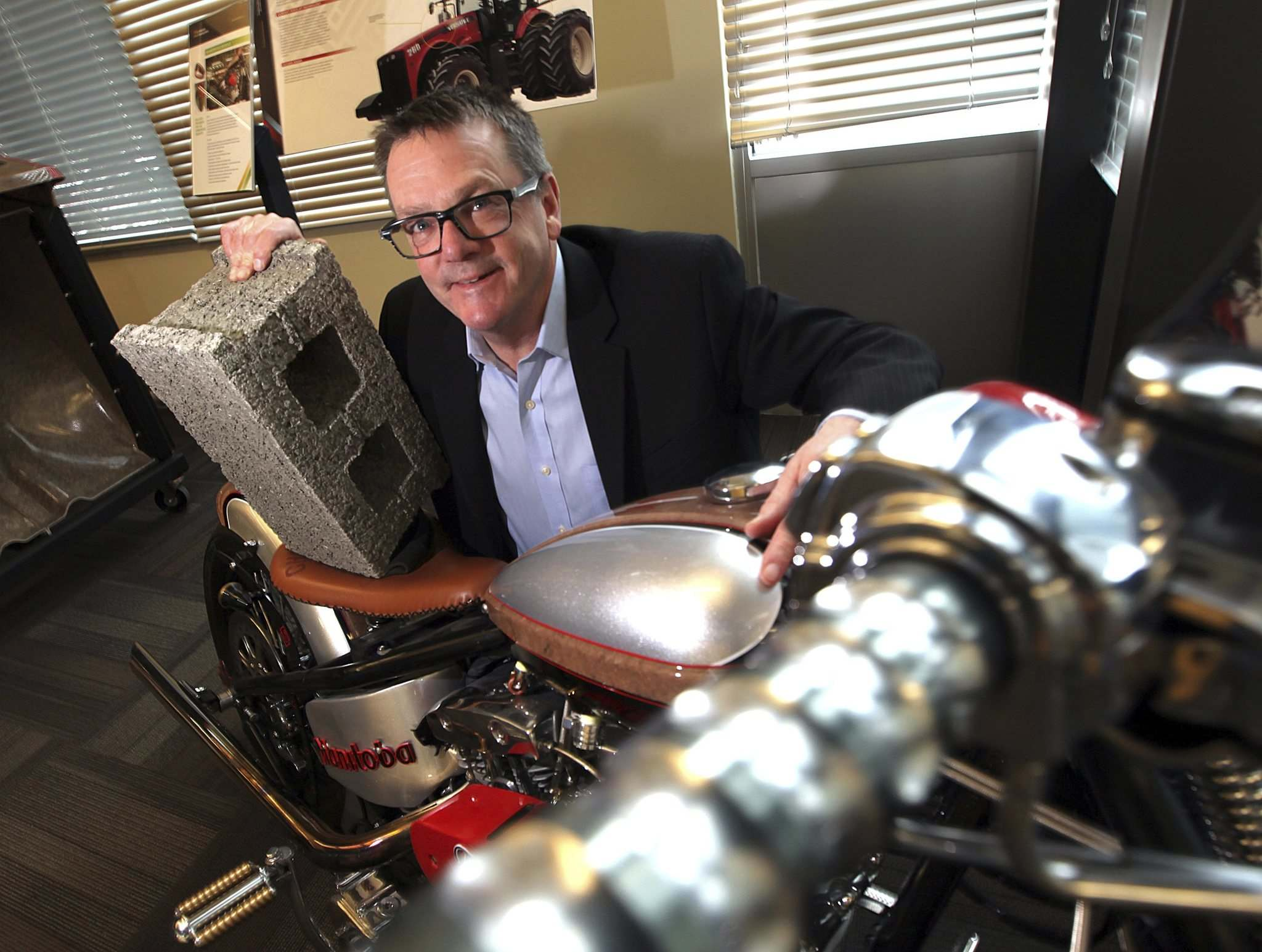 PHIL HOSSACK / WINNIPEG FREE PRESS</p><p>Composites Innovation Centre president and CEO Sean McKay crouches by innovative new products. The centre is part of Winnipeg&#39;s advanced manufacturing ecosystem.</p>